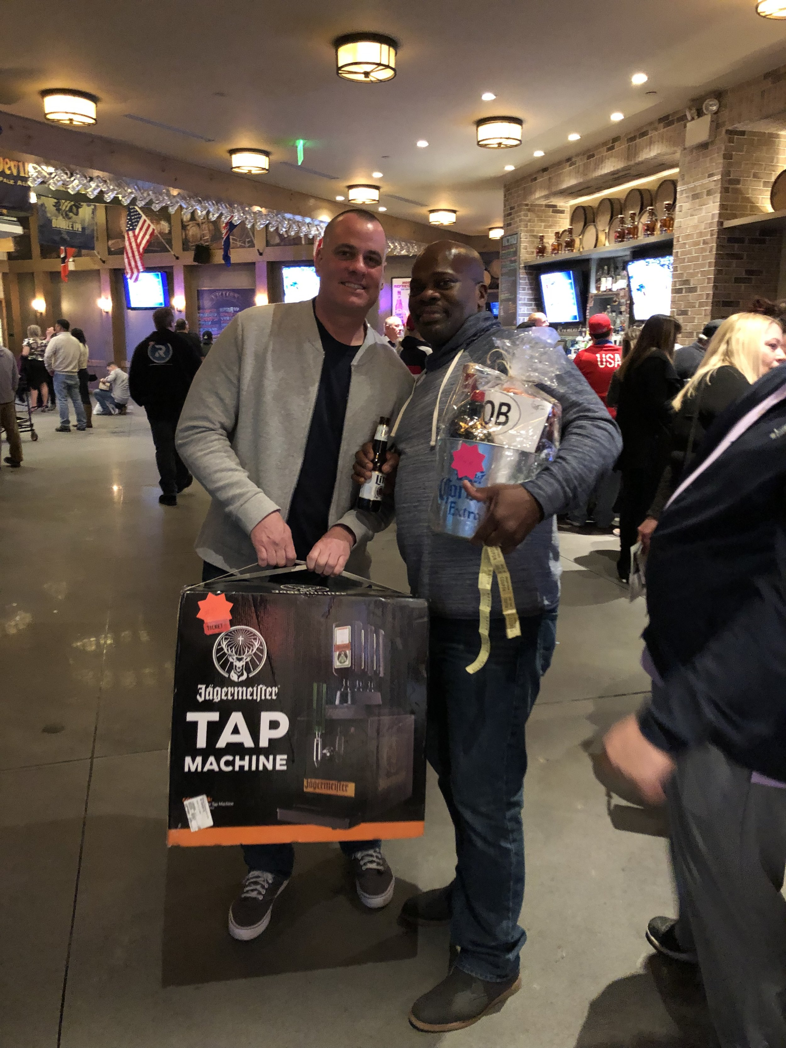 Liquor basket winner Donovan with double winner Jerry Malone who also took home a Jagermeister tap machine.