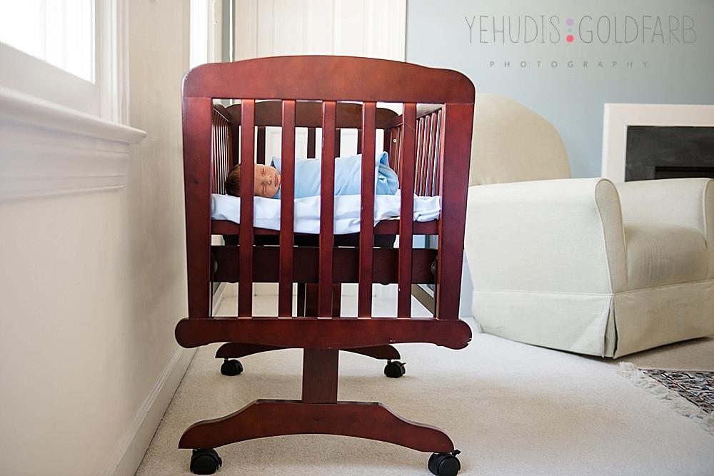 16_baby-sleeps-in-wooden-cradle-captured-by-yehudis-goldfarb-photography.jpg