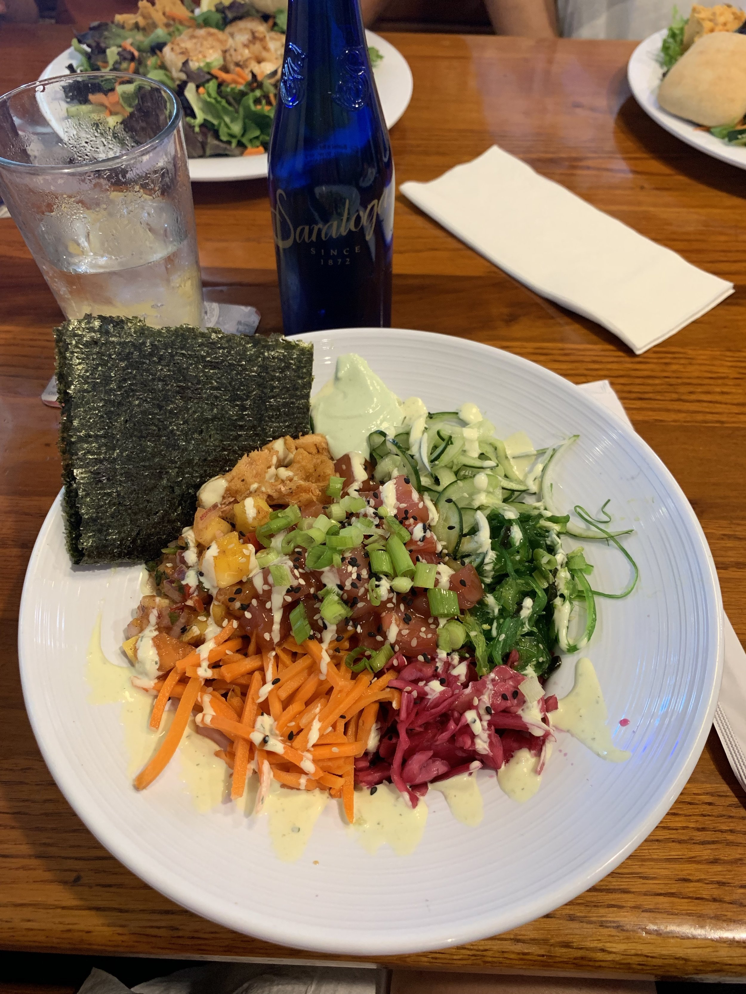 """Colorful Ahi tuna poke bowl at  Sunset Grille  celebrating Linda's birthday! Diet culture said """"order the salad"""" but when I looked at the menu I was in the mood for the Poke bowl! I substituted the white rice for black beans since I don't like the taste of white rice unless it is in sushi and it zaps my energy if I eat too much."""