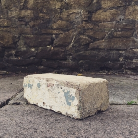A brick from the former Huwood building in Cardiff, 2016