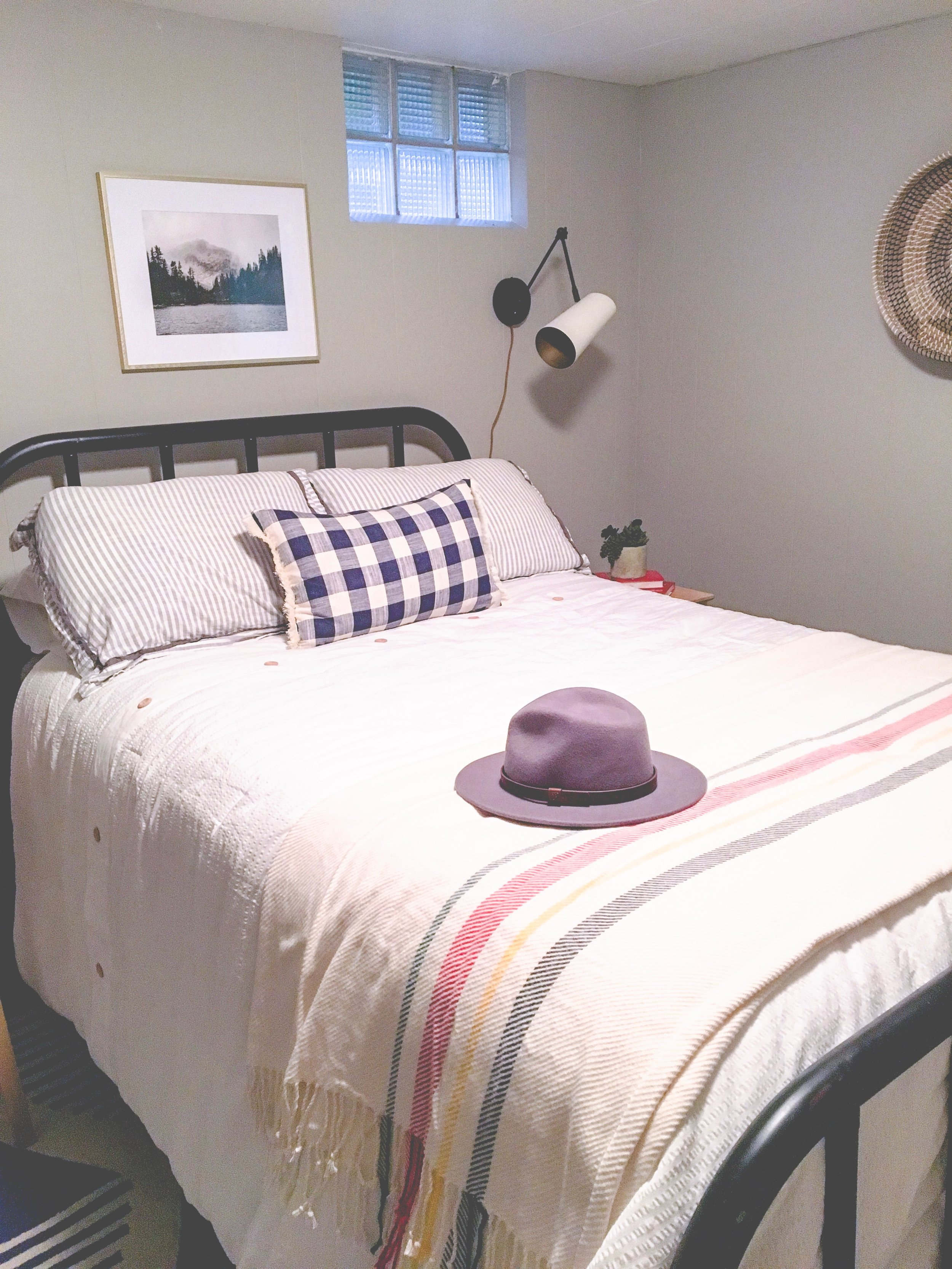Our boring guest room gets a whole new modern cozy chic cabin look! Learn how to redecorate your guest room so it feels cozy and welcoming.
