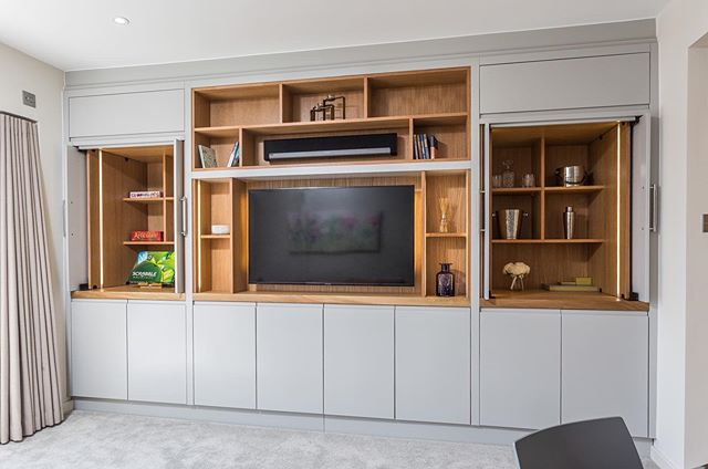"Keep your living room clutter free with smart and stylish storage solutions.  We installed this built in cocktail cupboard & toy cupboard at @boutiqueholidaylets ""The Lookout"" in Sandbanks which hides away all the clutter (swipe 👉) To enquire about bespoke storage for your home, email info@designdliving.co.uk . . #storagesolutions #builtinstorage #bespokefurniture #furnishingsuk #homedecor #homestyling #homeinterior #livingroomdecor #livingroom #livingroomdesign #moderninterior #modernhomes #modernist #homesweethome #interiorgoals #interiordecoration #interiordesigns #interiorinspiration #interiorinspo #housegoals #housedecor #propertygrams #interiorgram #instainteriors #designdliving"
