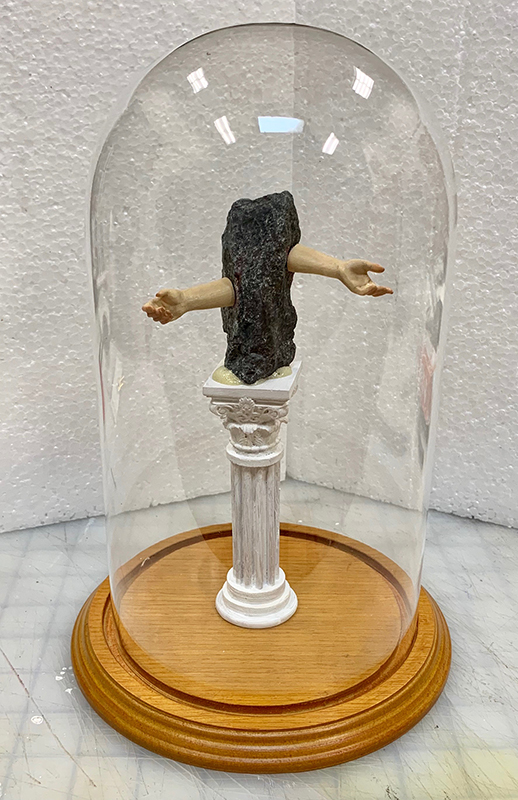 """ Artifact #L.1633L "", Granite, wood, glass showcase."