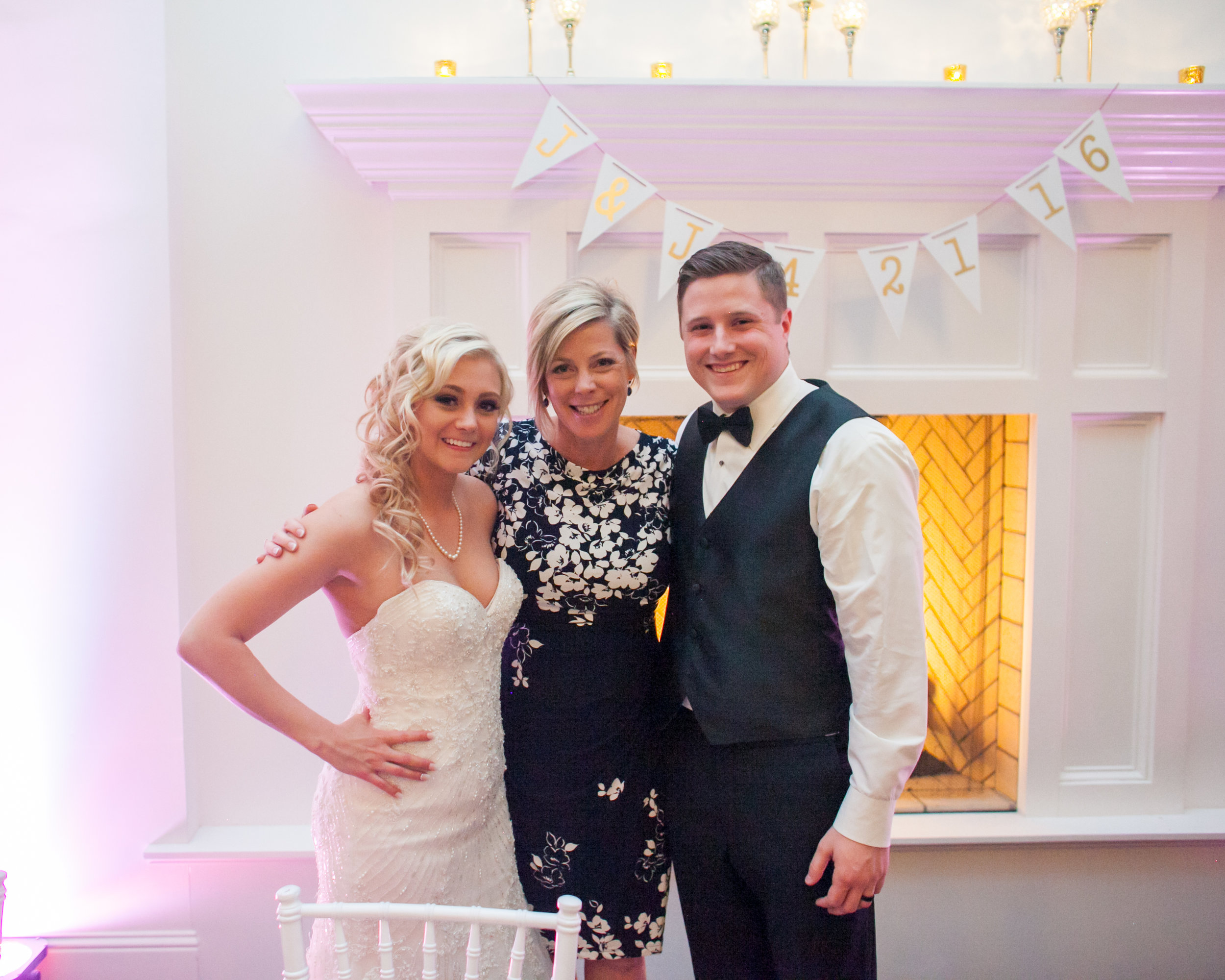 Image of my gorgeous couple with me (their wedding planner) at their reception by  Elliot Marsh Photography