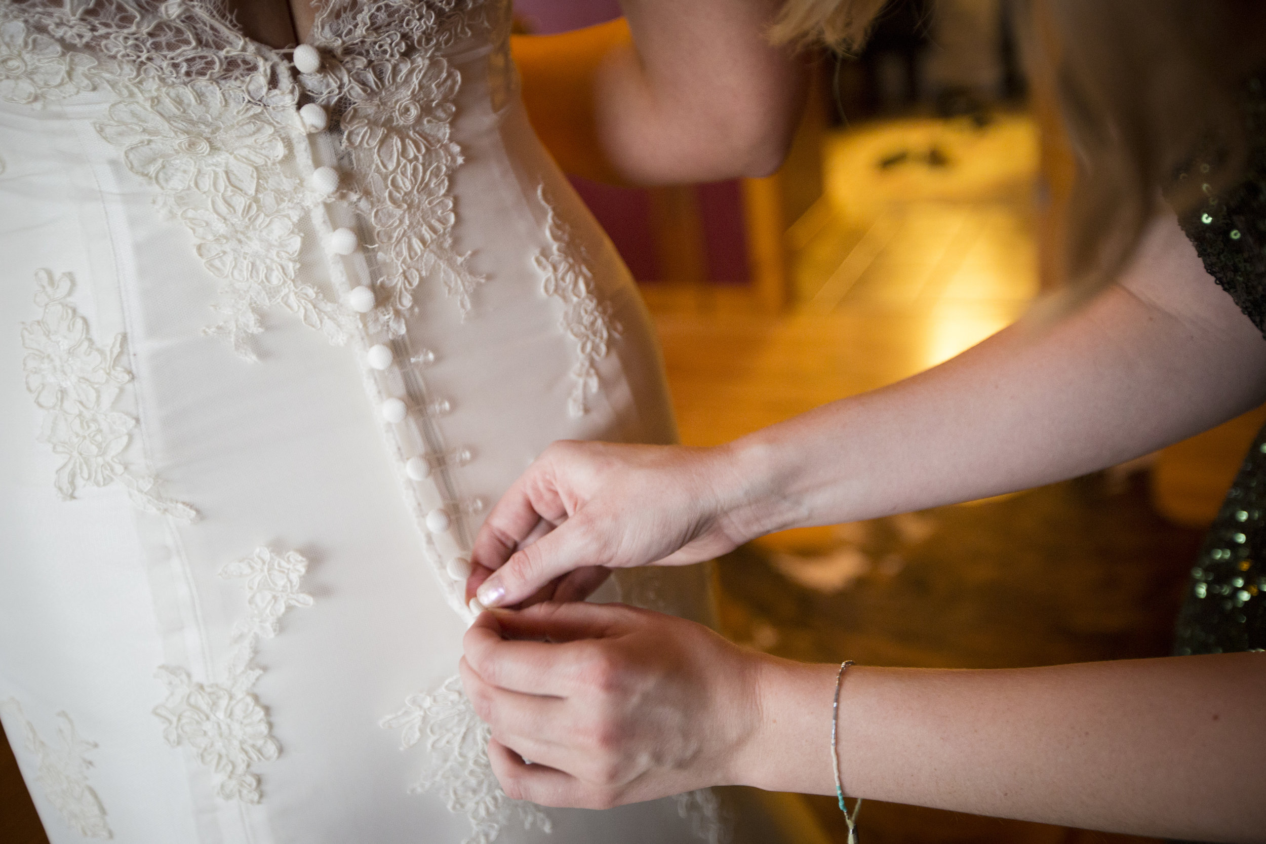 Buttoning the Dress by  Sheena Harper Photography