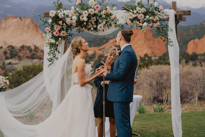 E & D's destination wedding captured by Kylie Morgan Photography at Garden of the Gods Resort.