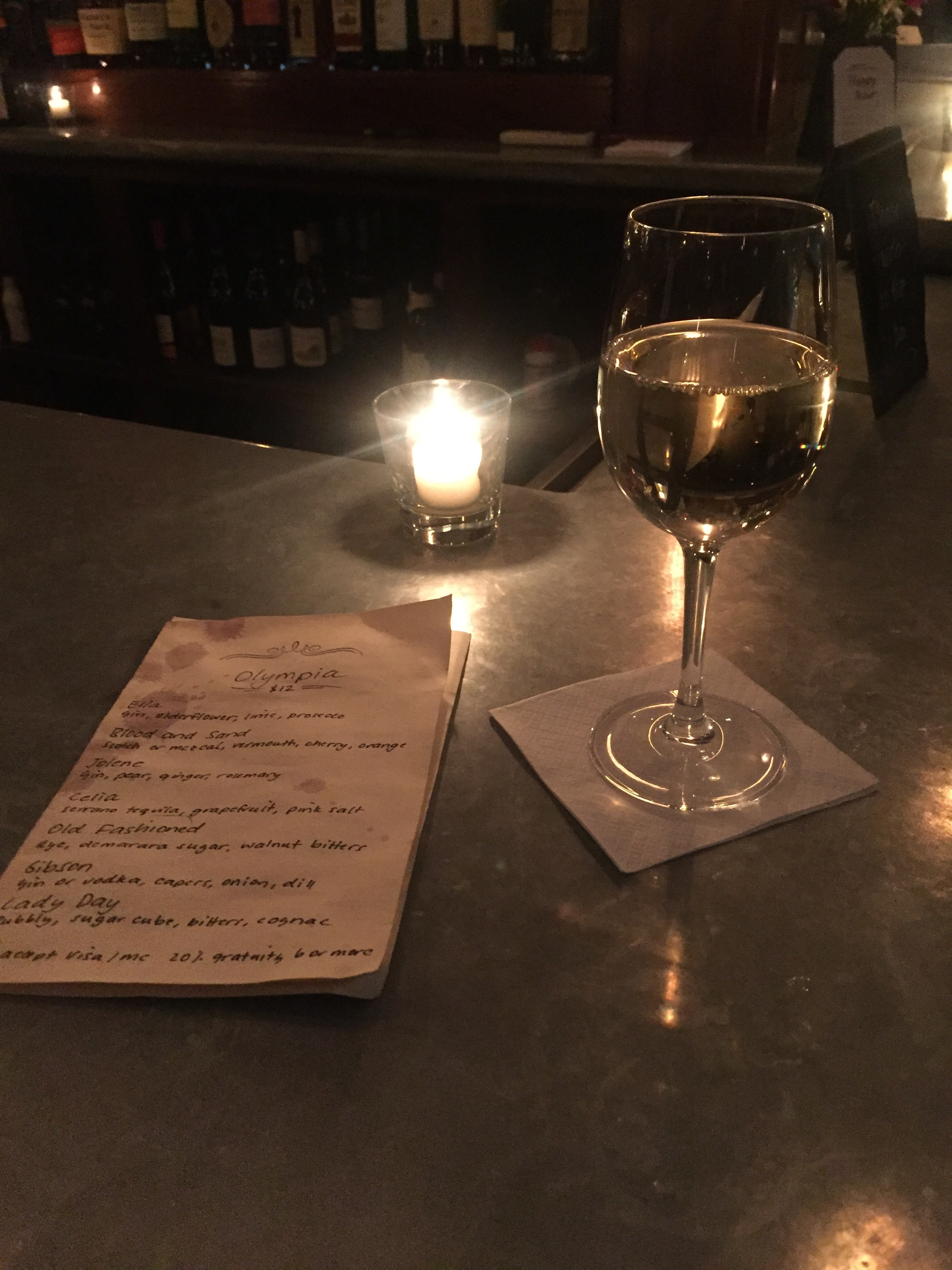 A glass of house white at Olympia Wine Bar
