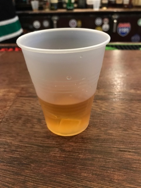 Tullamore Dew in a plastic cup at Nancy Whiskey