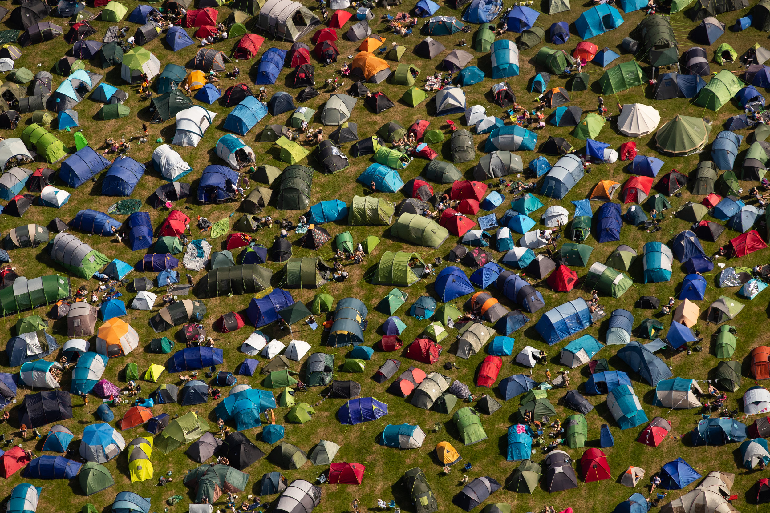 An aerial view of tents at the camping site for Glastonbury Festival at Worthy Farm in Somerset, England. The five day performing arts and music event Glastonbury Festival has officially opened, transforming the Somerset farm into a city for many thousands of people.