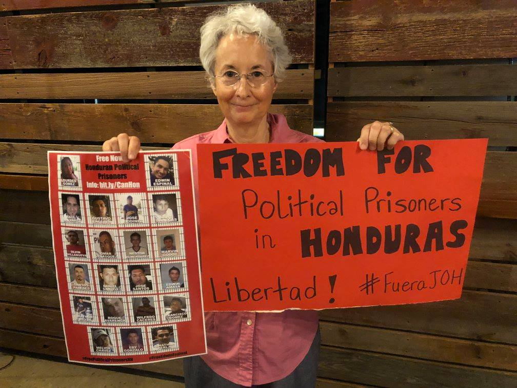Fran Glass stands with Honduran political prisoners at a May 9th, 2018 event at the Schlafly Bottleworks. At the event, human rights observer Karen Spring traced connections between private prison industries within the US and the introduction of maximum-security prisons in Honduras.
