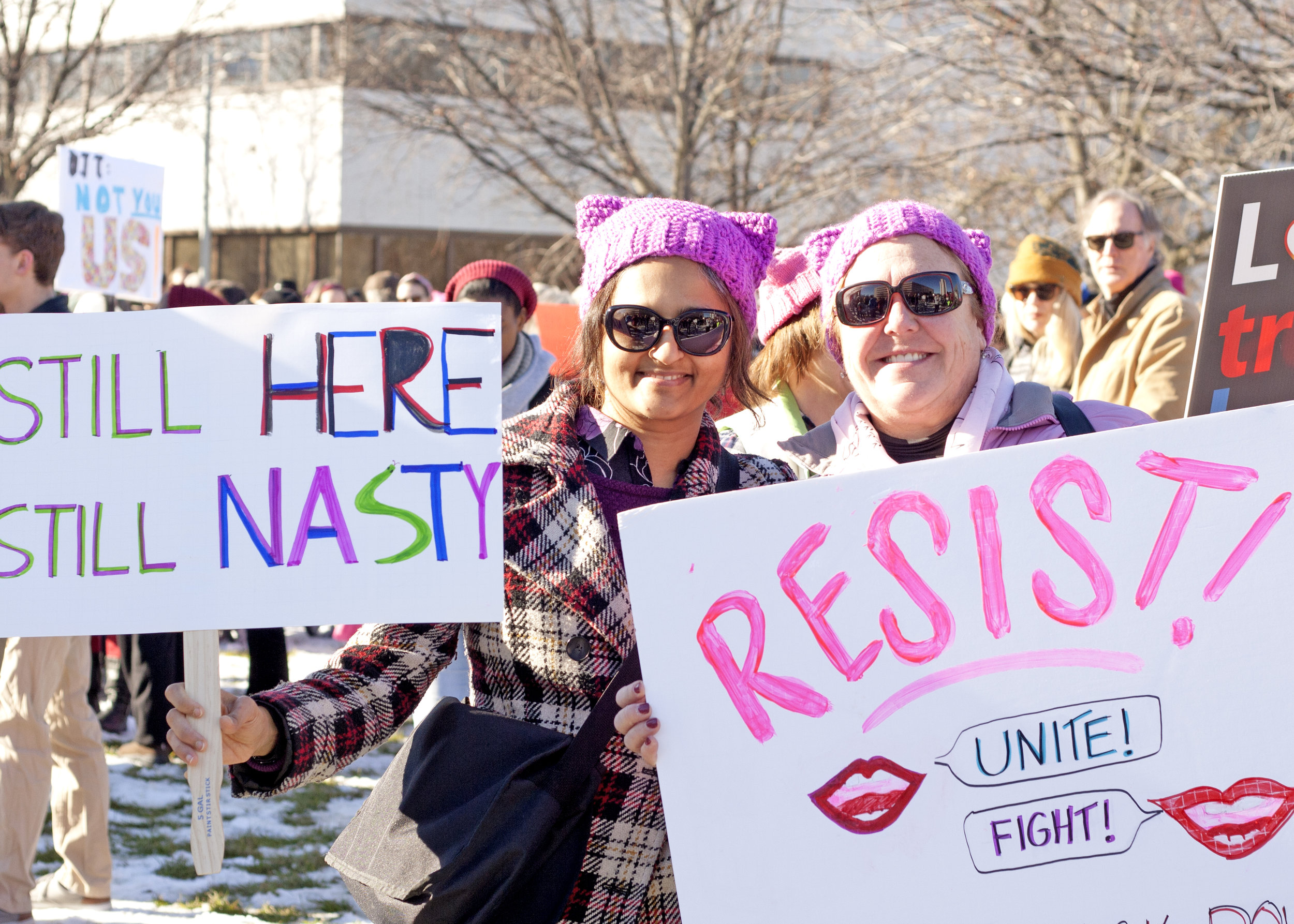 Maria and Sanjy hold signs at the Rally on Raleigh in Halifax Mall on Jan. 20.