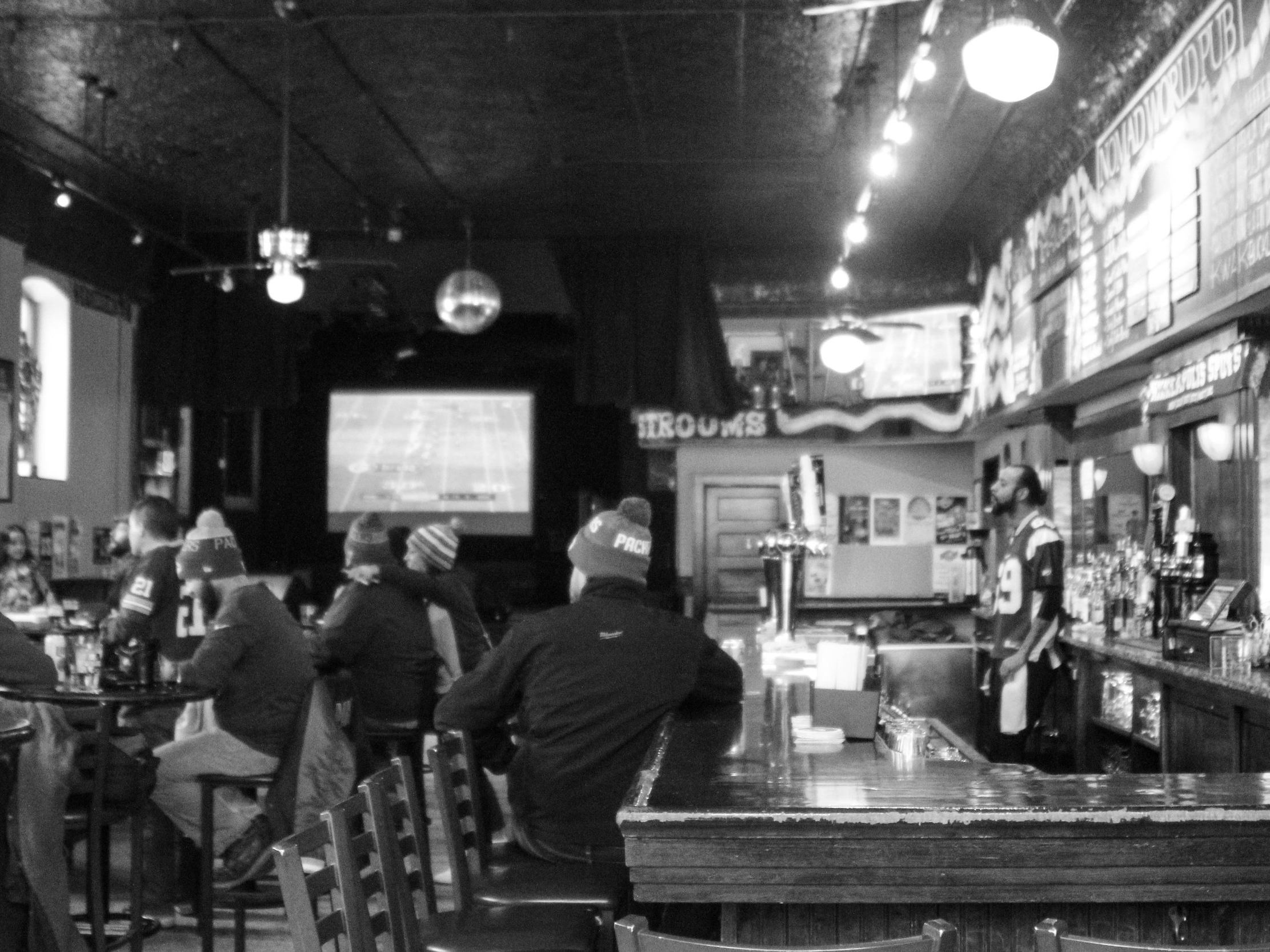 THE BAR - The bar at Nomad World Pub is host to a variety of events including viewing parties, live music, DJs, bocce tournaments, and so much more. With a full bar, patio access, widescreen TVs, and a food truck, the bar is a versatile and creative space perfect for entertaining guests.