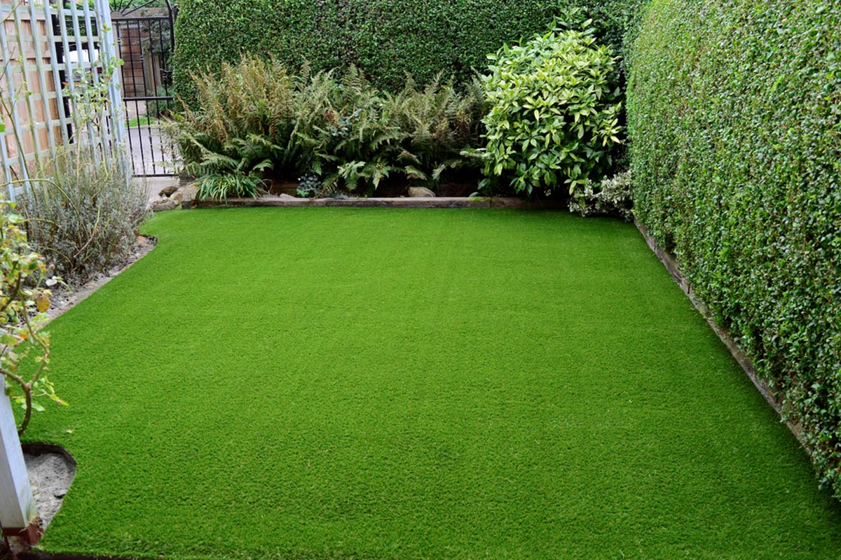 homeguide-new-artificial-turf-installation-in-residential-backyard.jpg