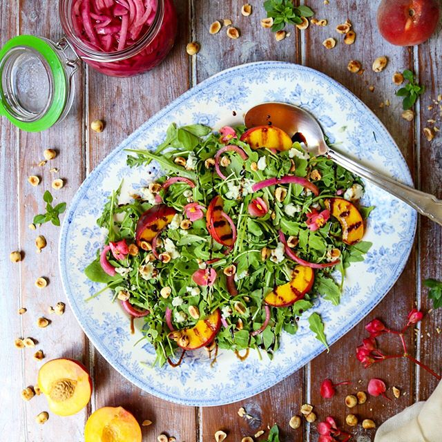 Griddled Peach, Rocket, Goat's Cheese, Pickled Red Onion and Toasted Hazelnut Salad. 🍑🥗 This flavour combination might be my very favourite summertime one. I understand the mix isn't for everyone (you should have seen my daughters face when I told her what it was!), but if you know, you know.  To me, the sweetness from the peaches works brilliantly with the creaminess from the cheese and the tartness from the pickled onions. And then some added crunch from the nuts and peppery-ness from the rocket makes a flavour match made in my heaven! 😍 All finished off with a drizzle of my favourite @belazu_co Balsamic Vinegar.  I have decamped to Georgia for the summer and I am taking a break from social media until I'm back. 🍑A recent health scare, followed by an unexpected operation has meant I didn't get the chance to write up all my recipes before I left. So for now, I am switching off and going to spend some much needed quality time with my family. Wishing you all a fabulous summer and looking forward to catching up when I'm back☀️
