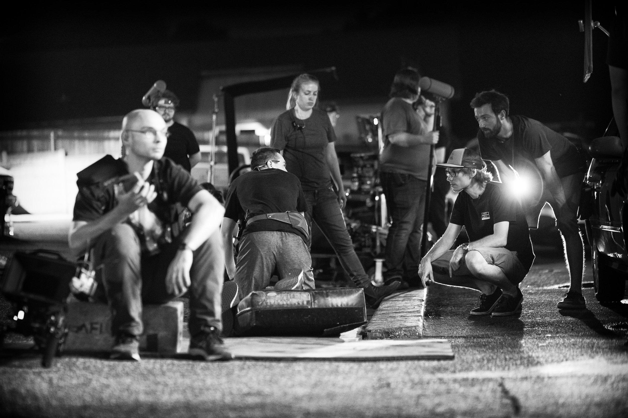 B CAM Operator  Marcin Banasiak  sets up a shot with Key Grip  Shannon Connally , Gaffer  Lukasz Dziedzic  and DP  Michal Wronski .