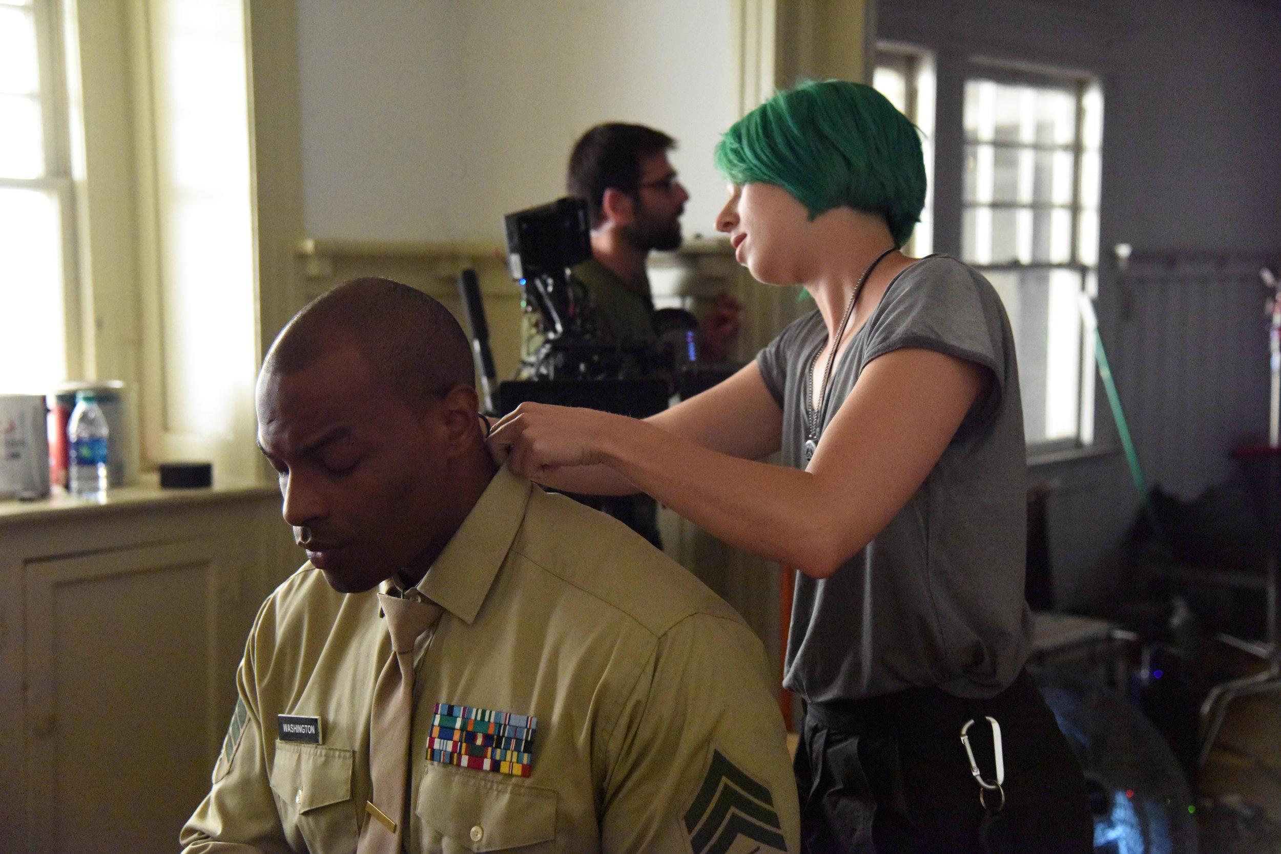 Costumer  Morgan DeGroff  preps Actor  Anthony Quinn Williams .