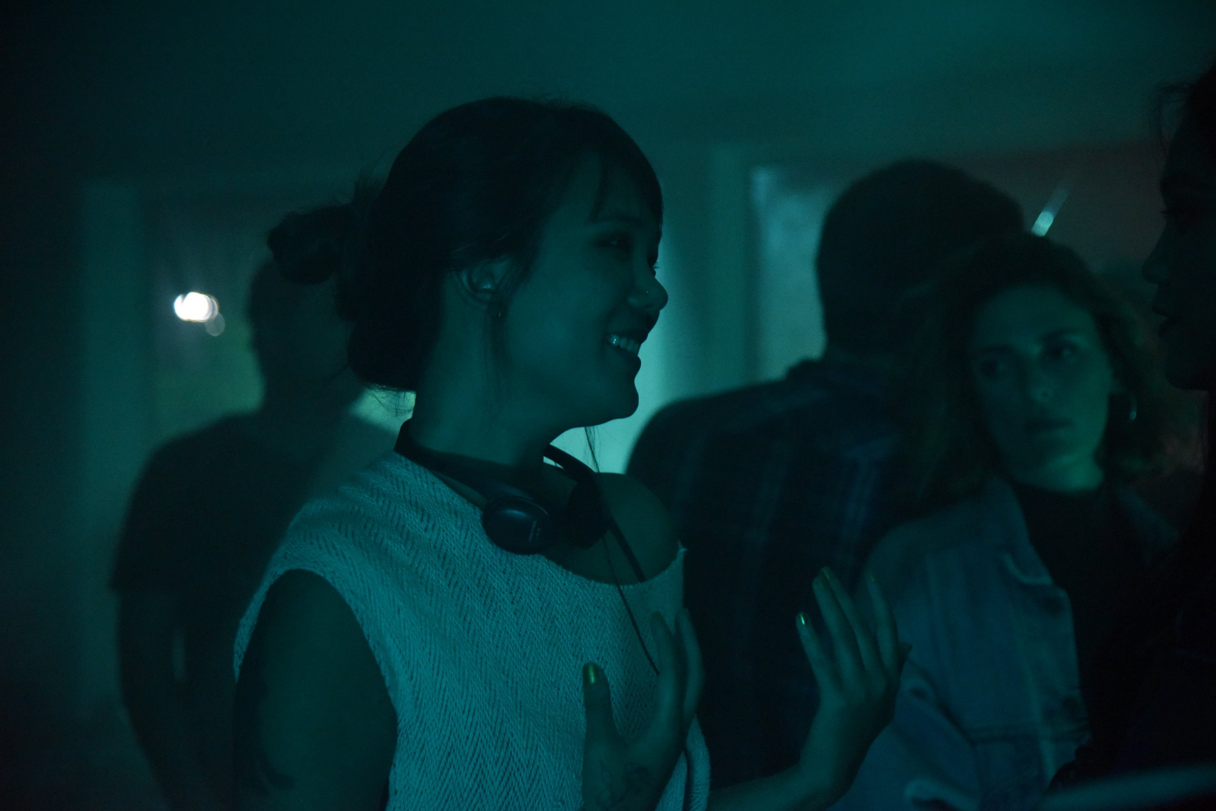 Director  Angela Chen  sets up the house party scene at 4AM.