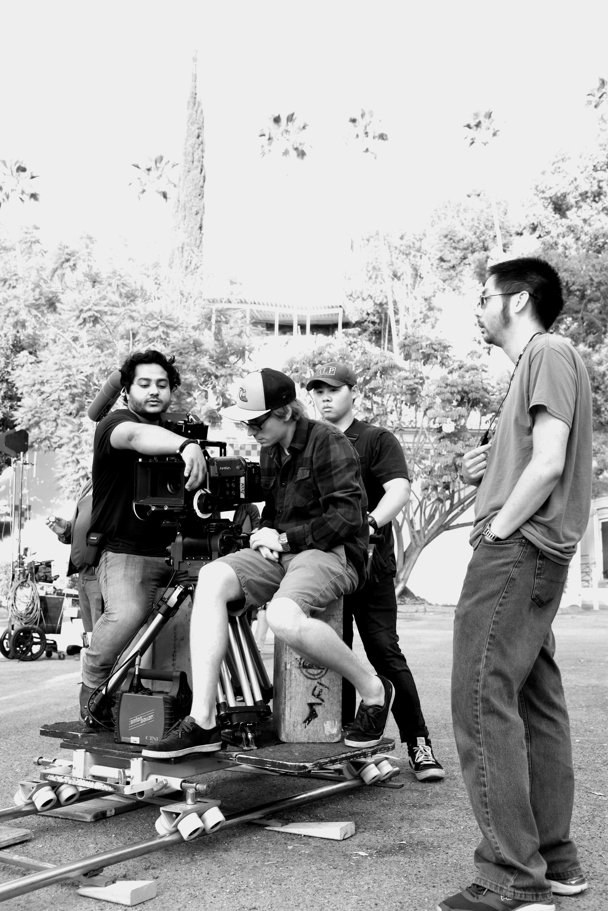 1st AC  Sam Chatterjee  sets focus for a dolly shot with DP  Michal Wronski  and 1st AD  Kevin Huie .
