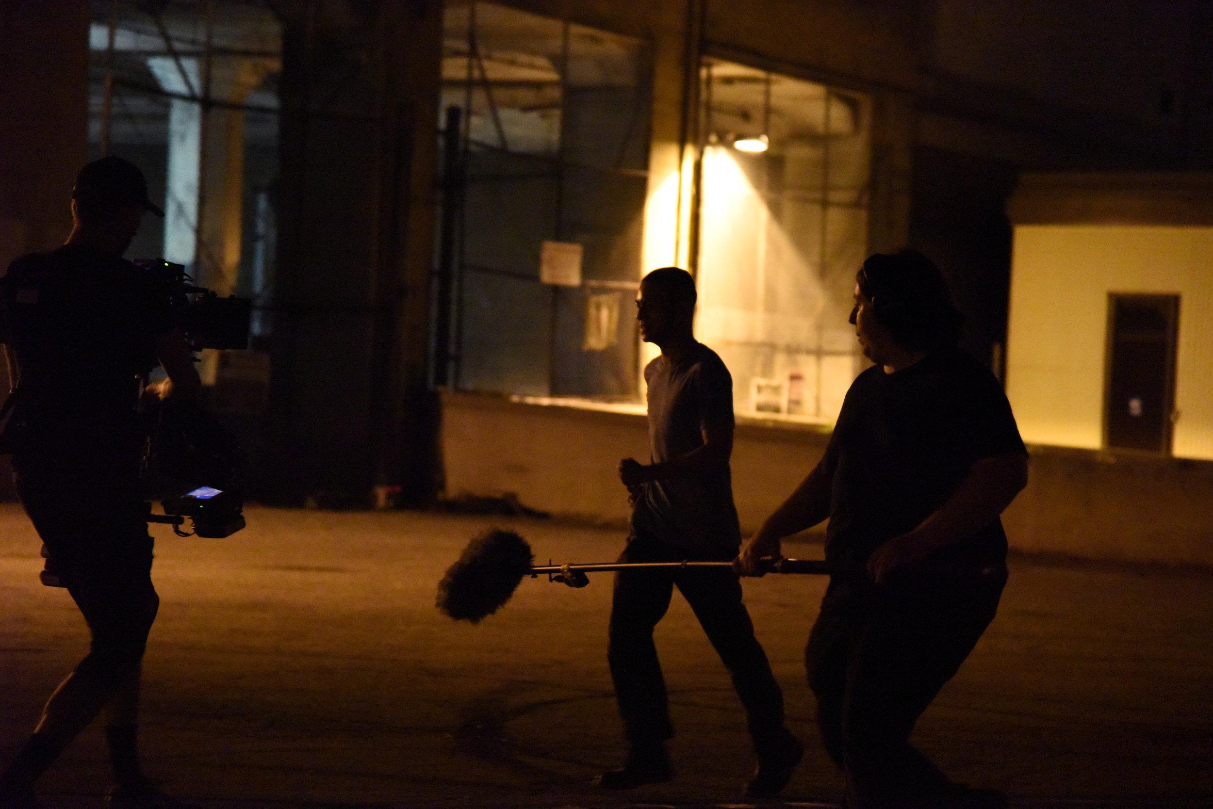 Steadicam Operator  Brennan Maxwell  and Boom Opertor  Matt Daugherty  tracks with actor  Brandon Soo Hoo.