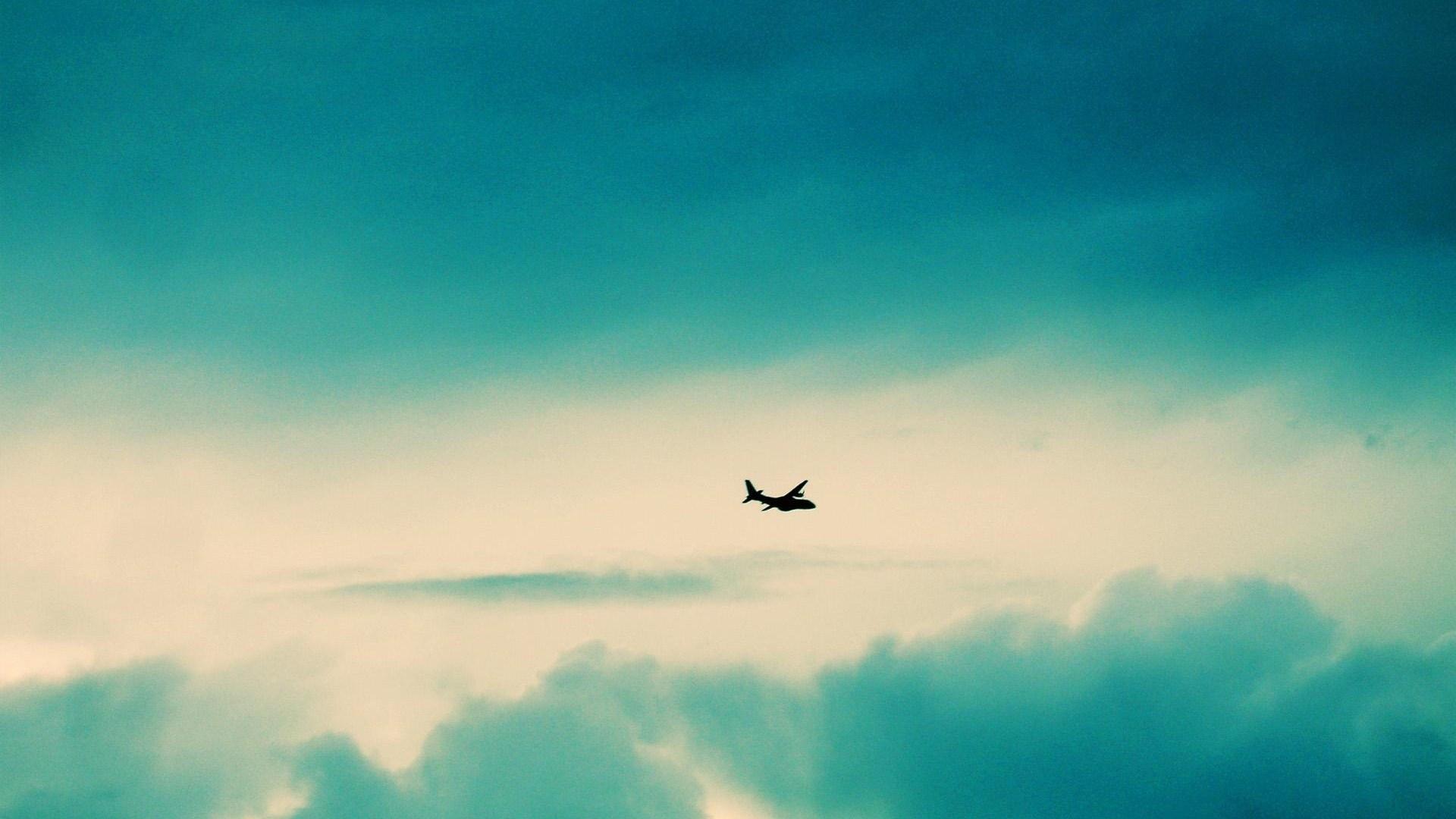 Aircraft Turquoise Clouds Desktop Wallpaper.jpg