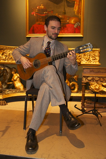 Isaac performing at NYC's Metropolitan Museum of art on a historic instrument from their collection