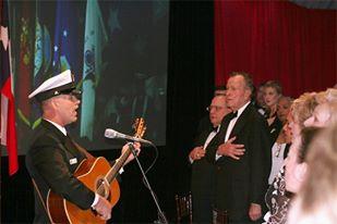 Wayne Taylor with Former President George H. Bush, singing the National Anthem
