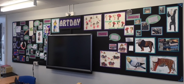 This was a display of a whole school Art day. Each year group studied a different form of art such as printing, painting, modelling, collage, sketching and photography.