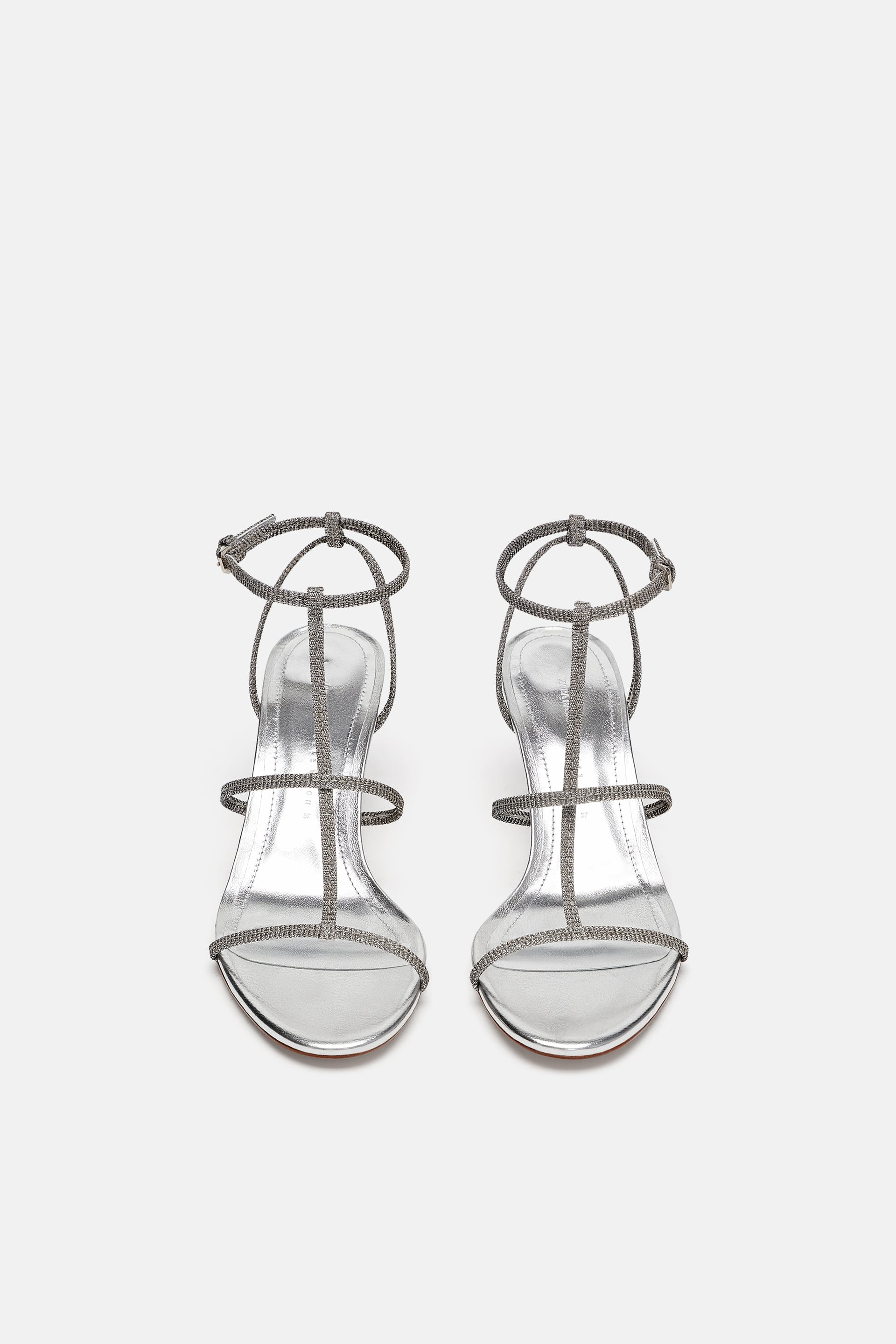 https://www.zara.com/us/en/heeled-sandal-with-laminated-straps-p16331301.html?v1=7259067&v2=107462