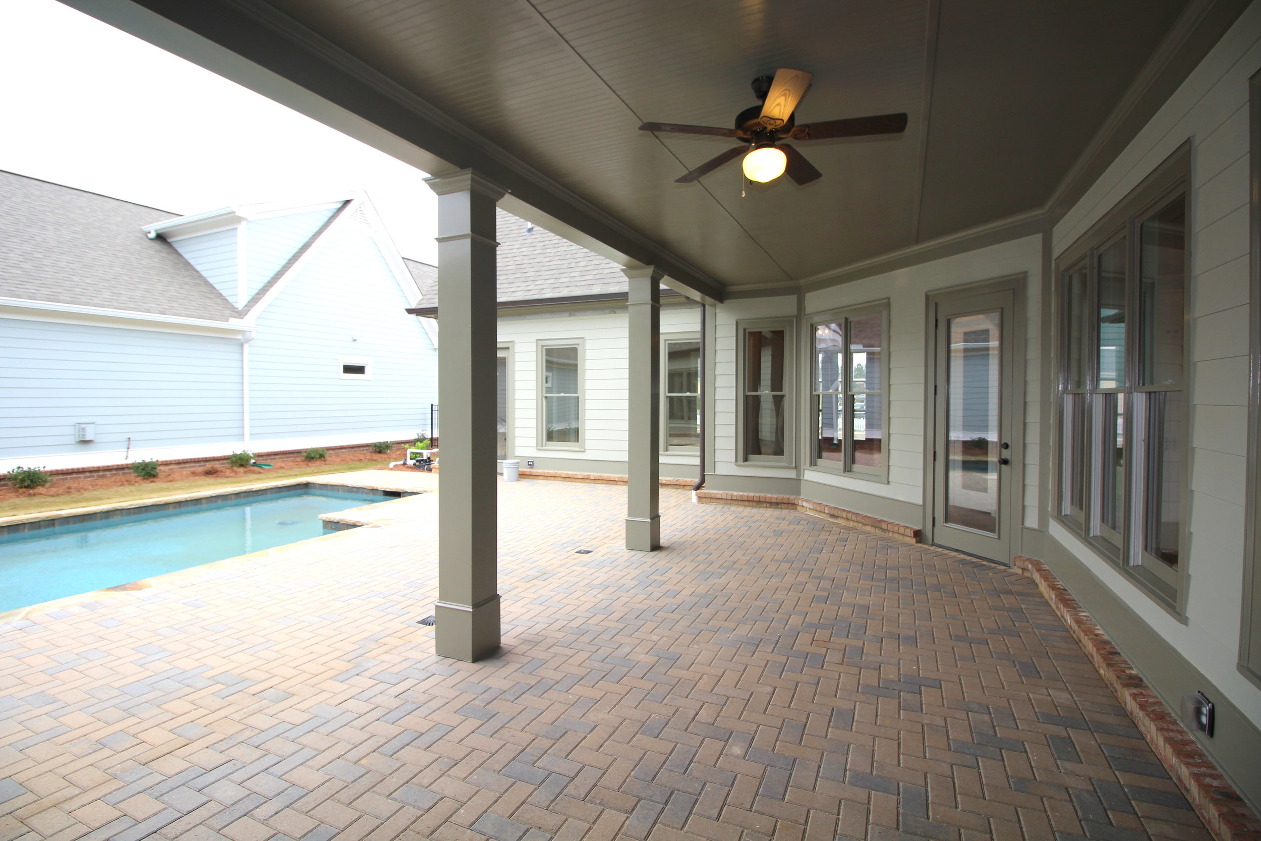brick-paver-covered-back-porch-1756-greenleffe-drive-statham-ga-30666-the-georgia-club-oconee-county-oconee-springs-athens-area-home-for-sale-courtyard-homes.JPG