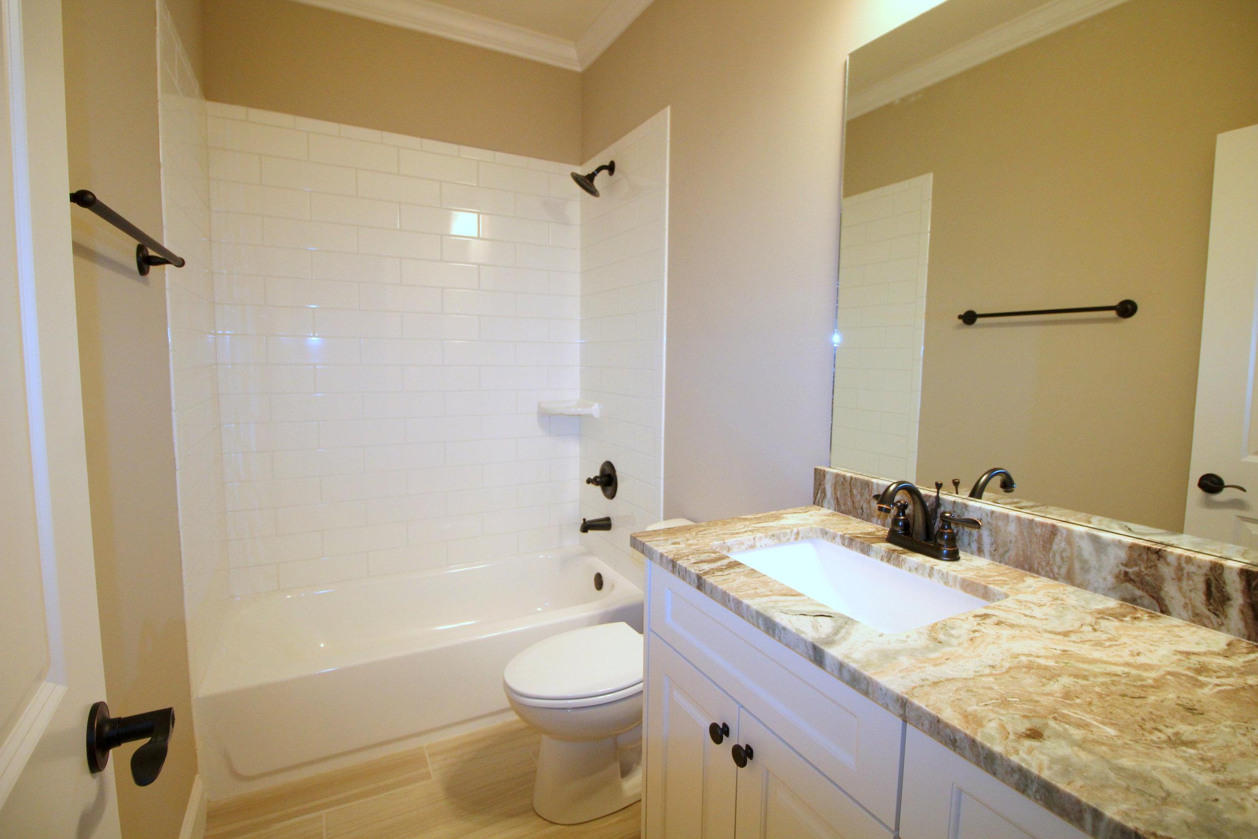marble-bathroom-counter-tops-1756-greenleffe-drive-statham-ga-30666-the-georgia-club-oconee-county-oconee-springs-athens-area-home-for-sale-courtyard-homes.JPG