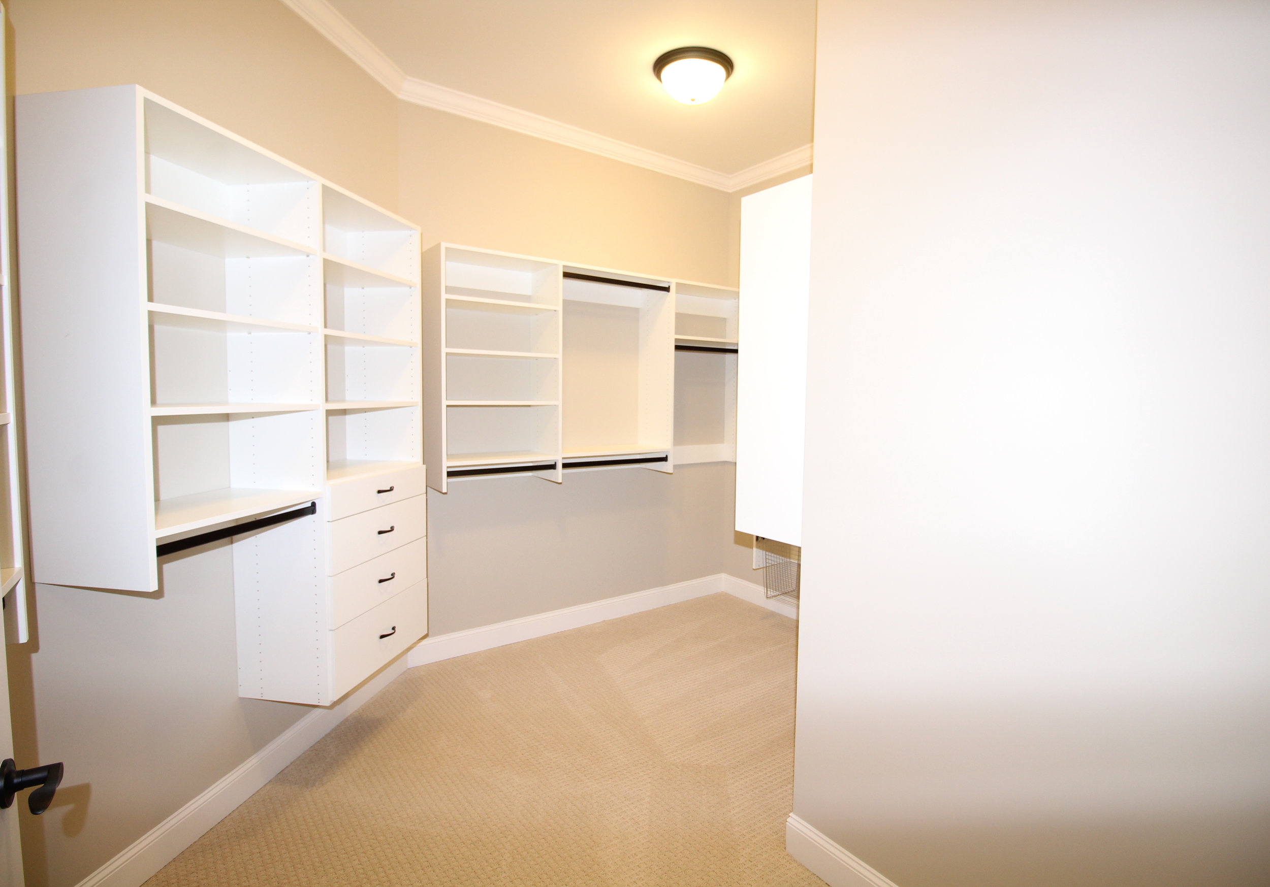 over-sized-master-closet-built-in-shelves-1756-greenleffe-drive-statham-ga-30666-the-georgia-club-oconee-county-oconee-springs-athens-area-home-for-sale-courtyard-homes.JPG