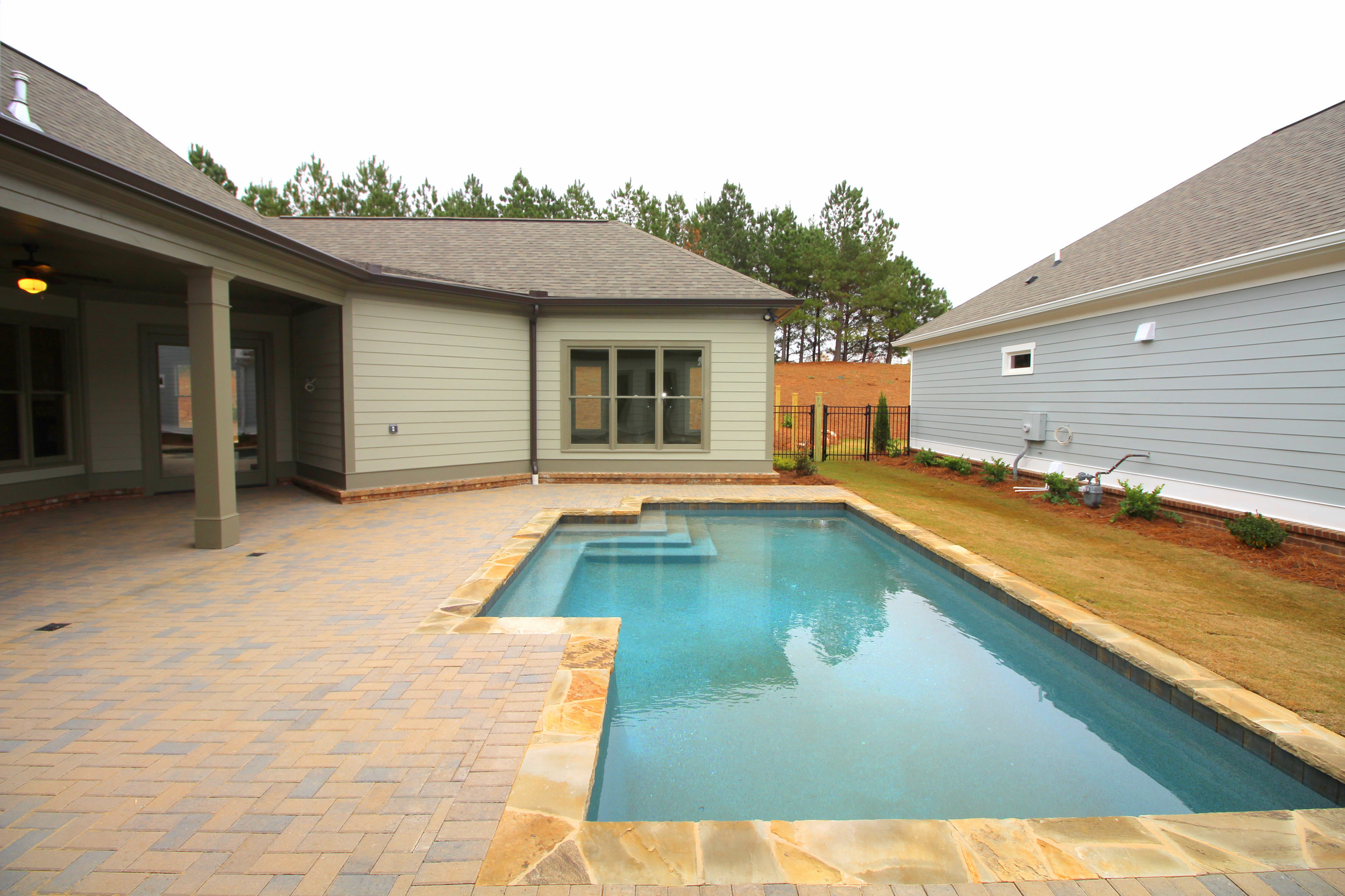 rock-trimmed-paver-pool-edge-1756-greenleffe-drive-statham-ga-30666-the-georgia-club-oconee-county-oconee-springs-athens-area-home-for-sale-courtyard-homes.JPG