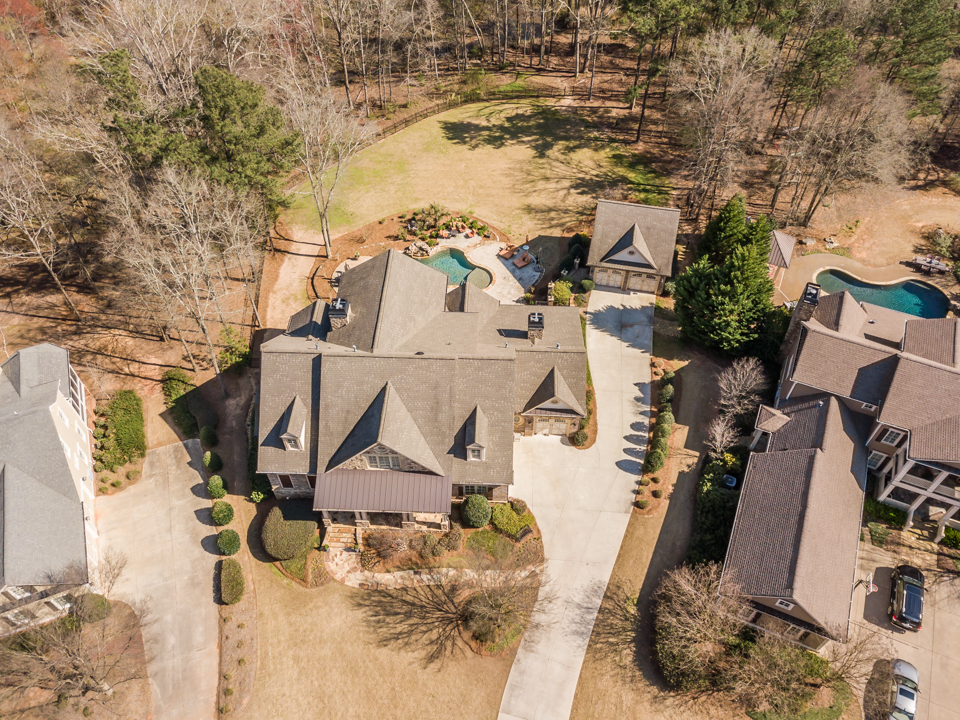 1310-longwood-park-$1,387,000-clubside-living-oconee-springs-courtyard-homes-house-for-sale-georgia-club-athens-sarah-lee-realtor-aerial-front-over-view.jpg