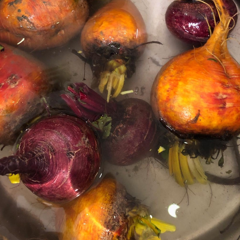 Step 2 - Scrub beets in cold water with vegetable wash and a clean, rough sponge. You want to make sure all loose dirt and debris is removed! Don't worry too much about dirt on the stem area - we're about to remove this.