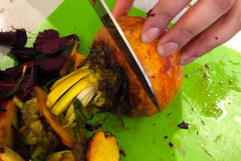 Step 3 - Remove stems with chef's knife. Cut just below the darkened area at the top of the root.