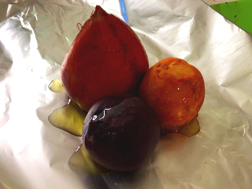 Step 4 - Place beets on a sheet of aluminium foil and drizzle with olive oil. The aluminium sheet will need to be big enough to wrap up the beets. Place the covered beets on a metal baking tray.