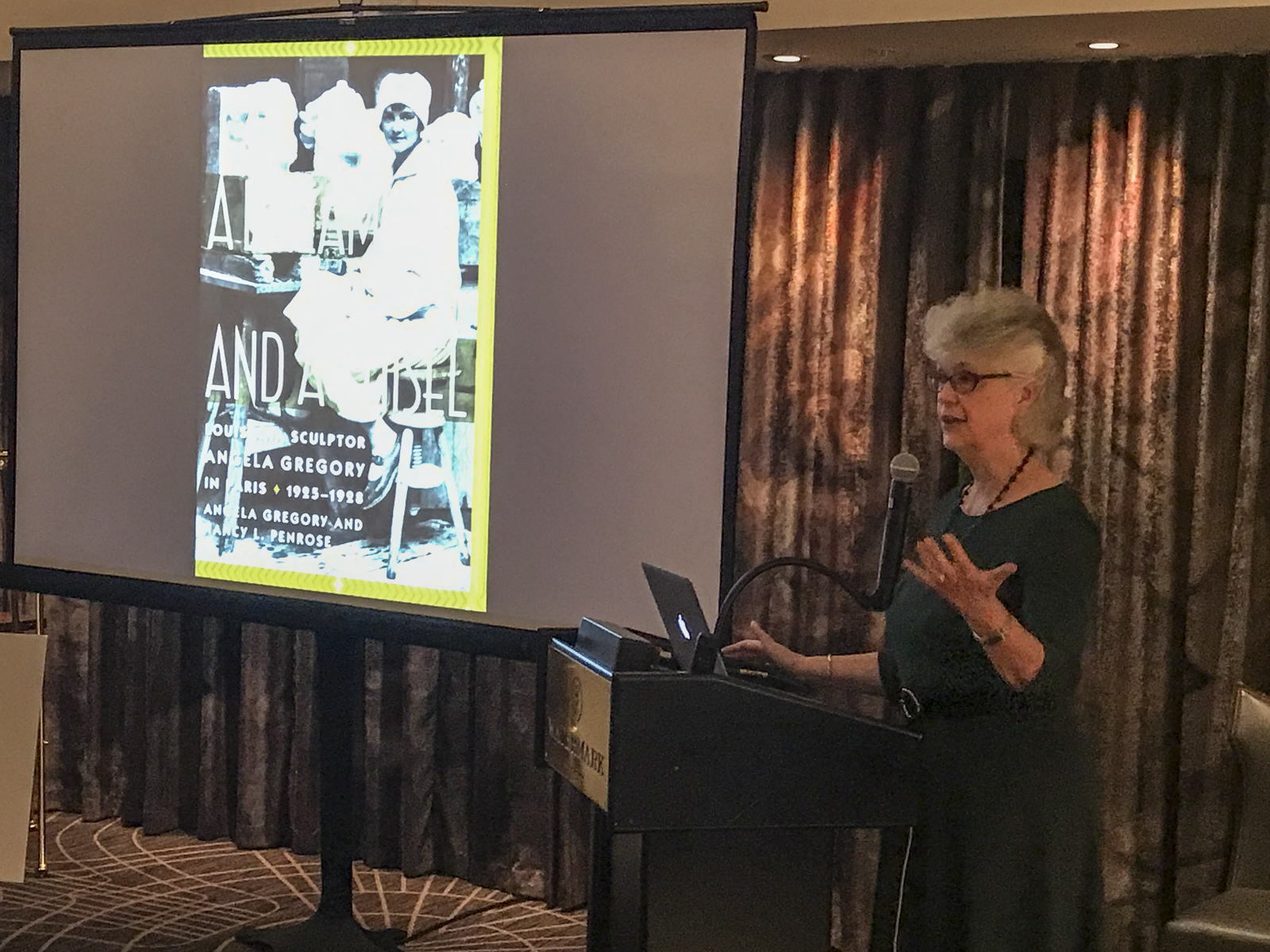 Nancy Penrose, co-author, speaking in The Gregory restaurant, Watermark Hotel, Baton Rouge, at the launch of  A Dream and a Chisel , 7 February 2019.