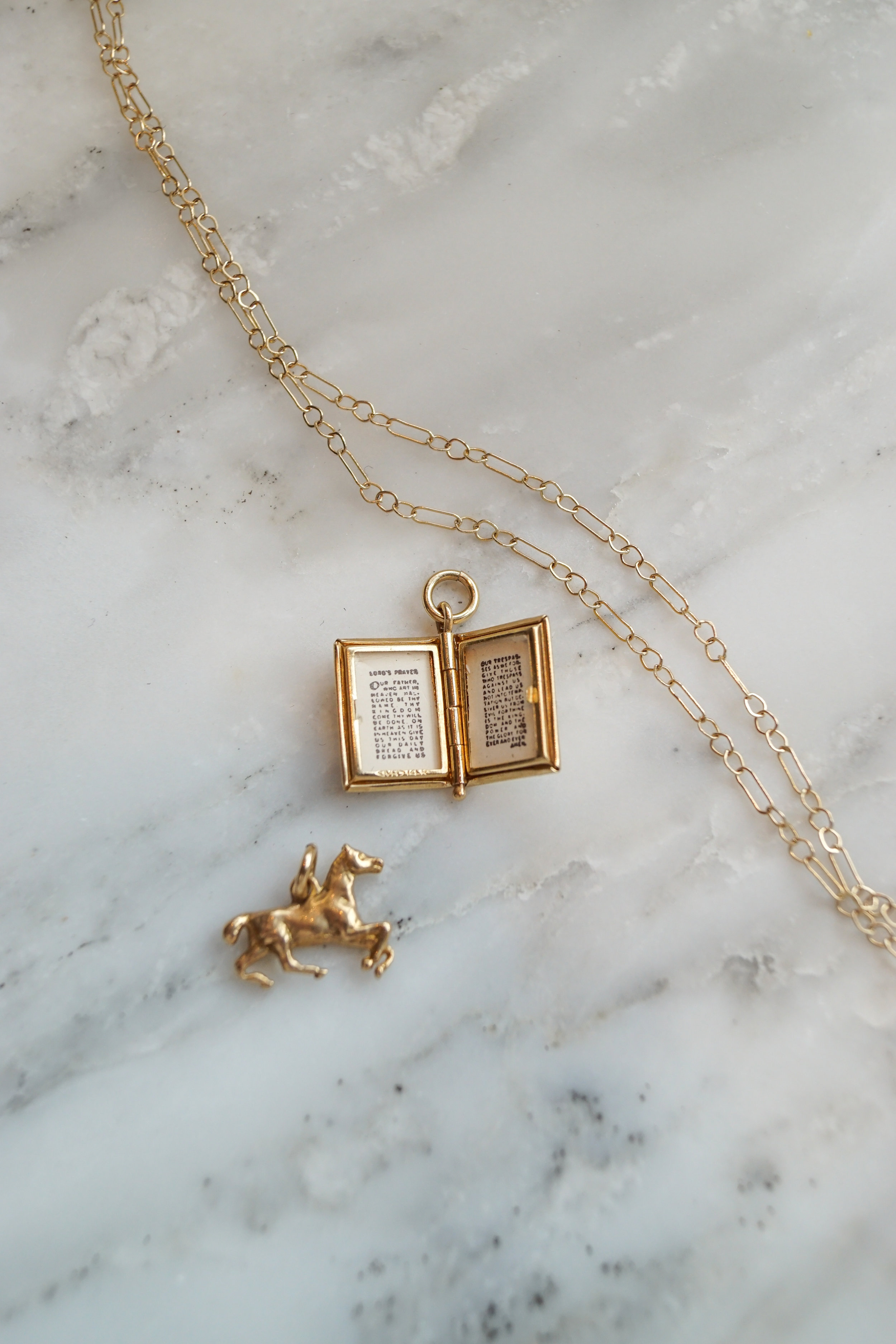 The Lord's Prayer book locket holds a complete script of the Lord's Prayer inside!