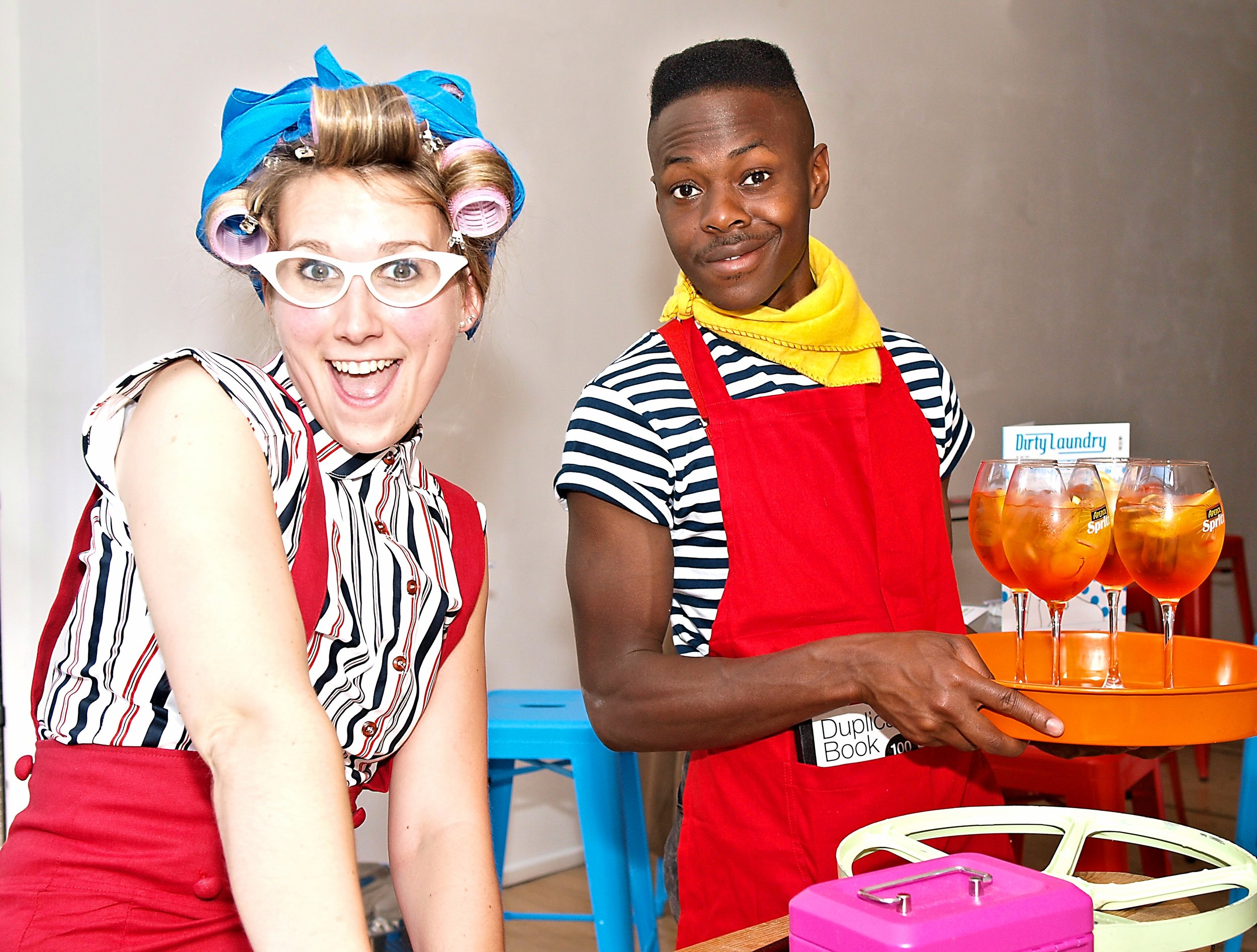 Washing machine made cocktails anyone? Waiter and Waitress serving squeaky clean cocktails at Meredith Collectives glamorous 'Dirty Laundry' event 2015.