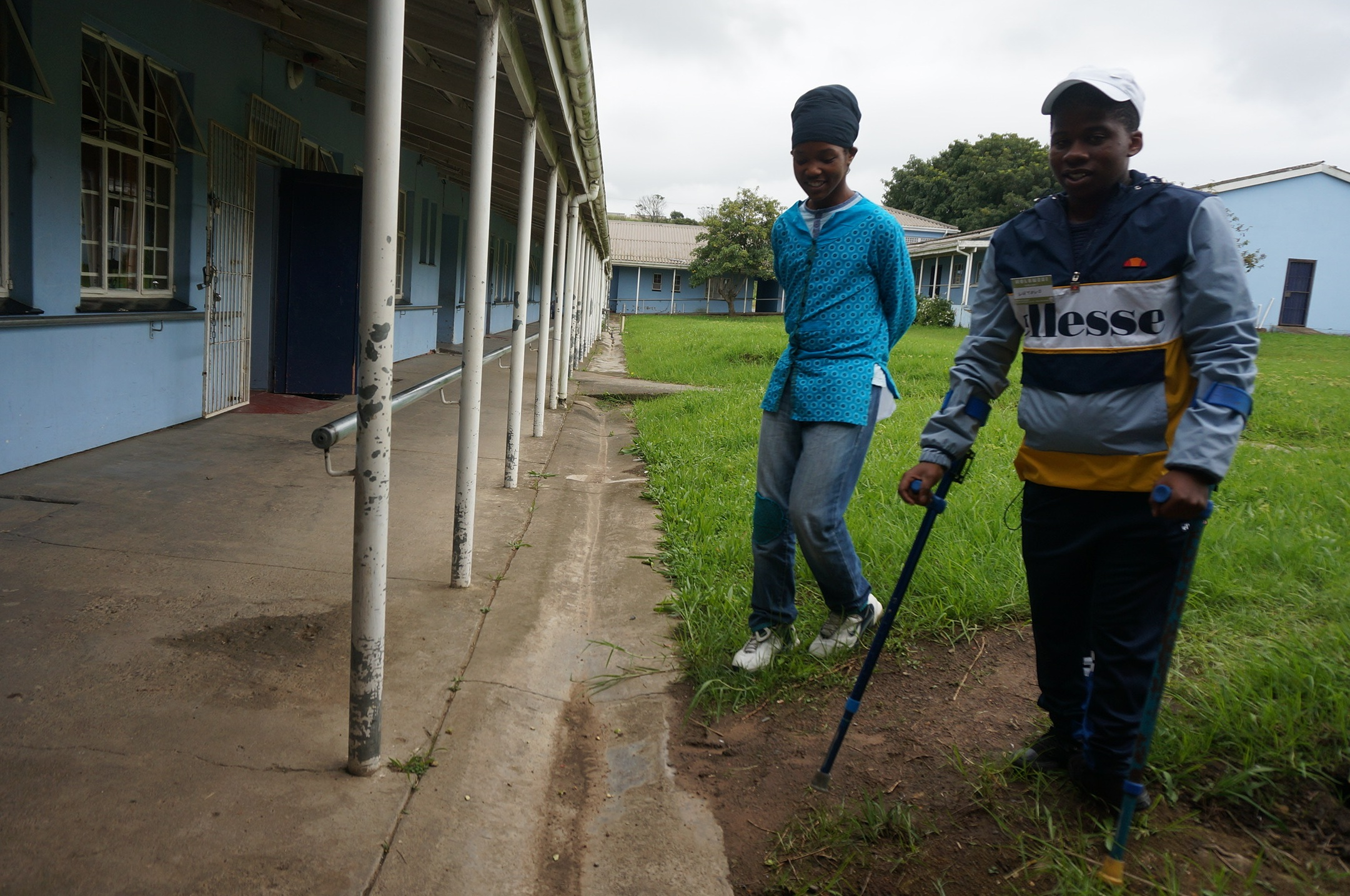 Students get around the school campus with varying levels of accessibility between buildings and other facilities.    Credit: UN-Habitat