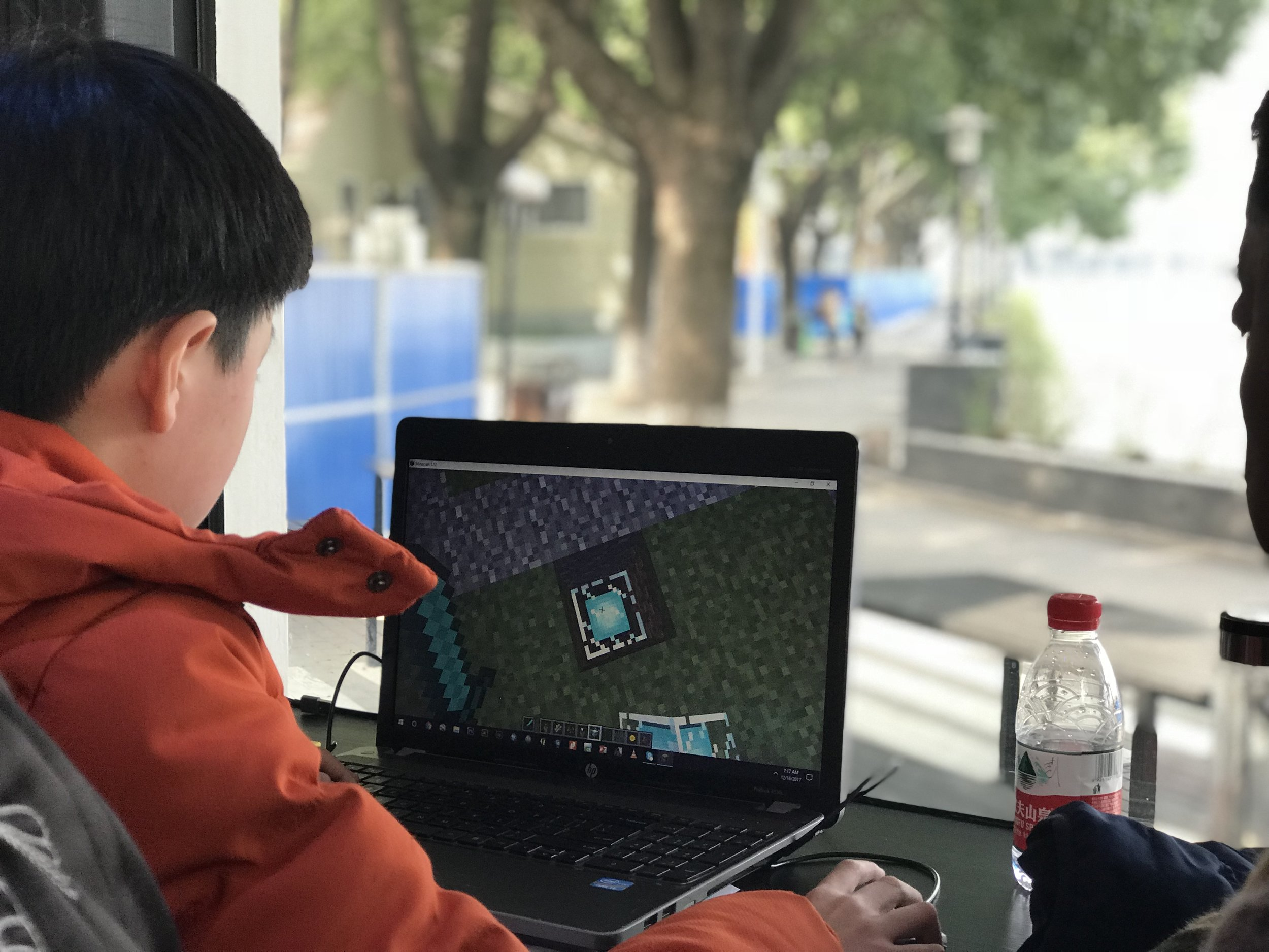 A young participant starts to design with Minecraft. Credit: UN-Habitat