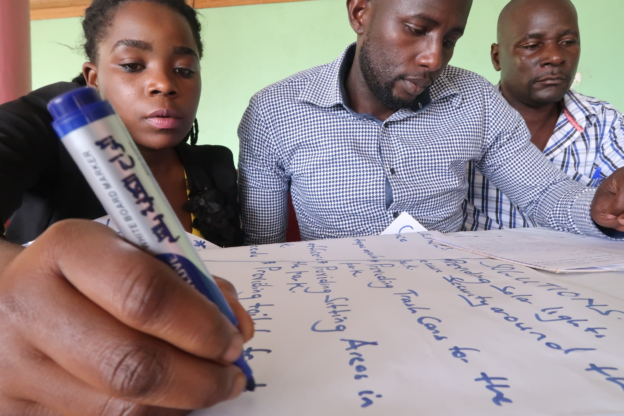 Men and women teamed up to generate ideas for Namuwongo 8th Street. Credit: UN-Habitat