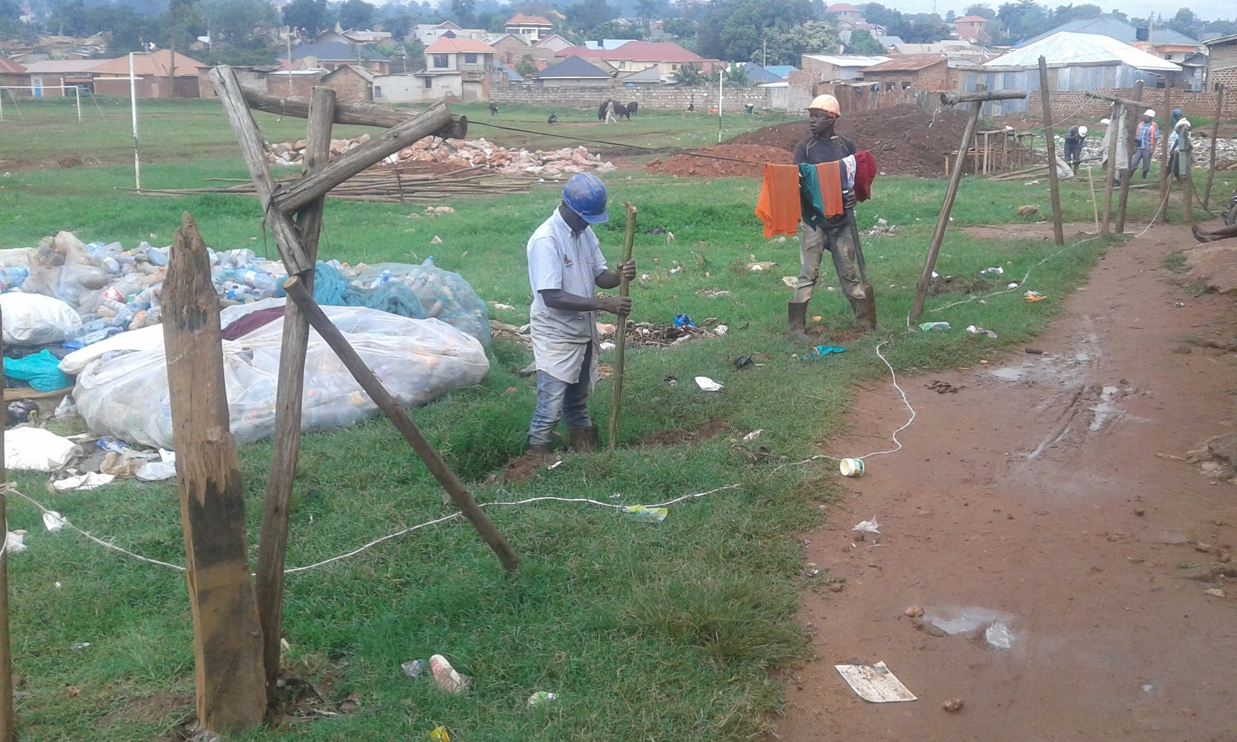 Community members work to clean up garbage and build a safe walkway. Credit: UN-Habitat