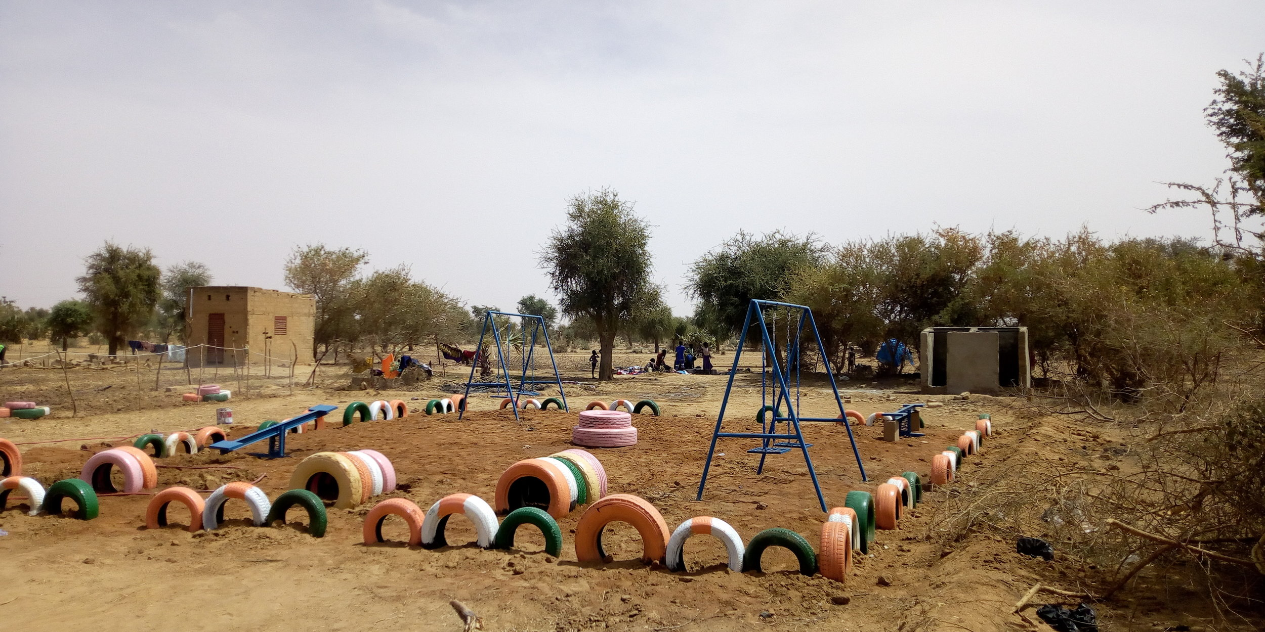 A playground introduces color and fun to the park. Credit: UN-Habitat