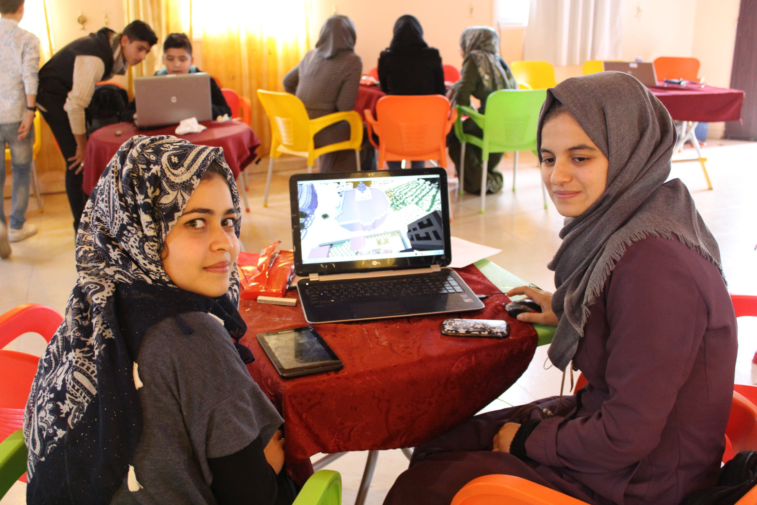 A team of women works to design the Beit Lahia community garden with the help of Minecraft. Credit: UN-Habitat