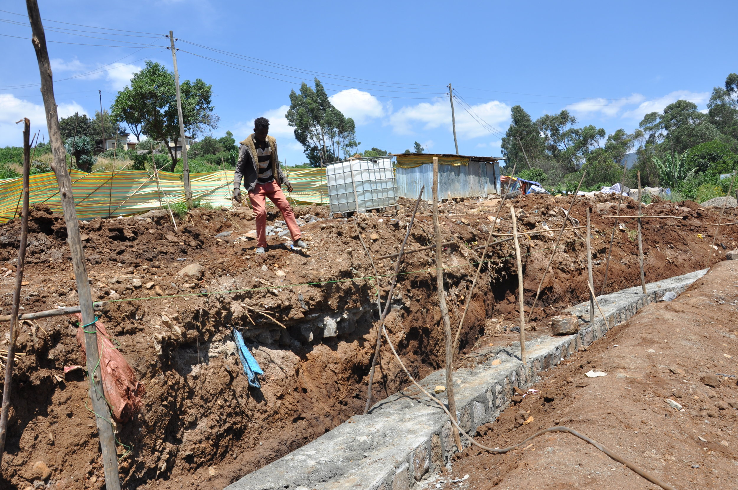 Construction of the site began with building strong walls to border the park. Credit: UN-Habitat