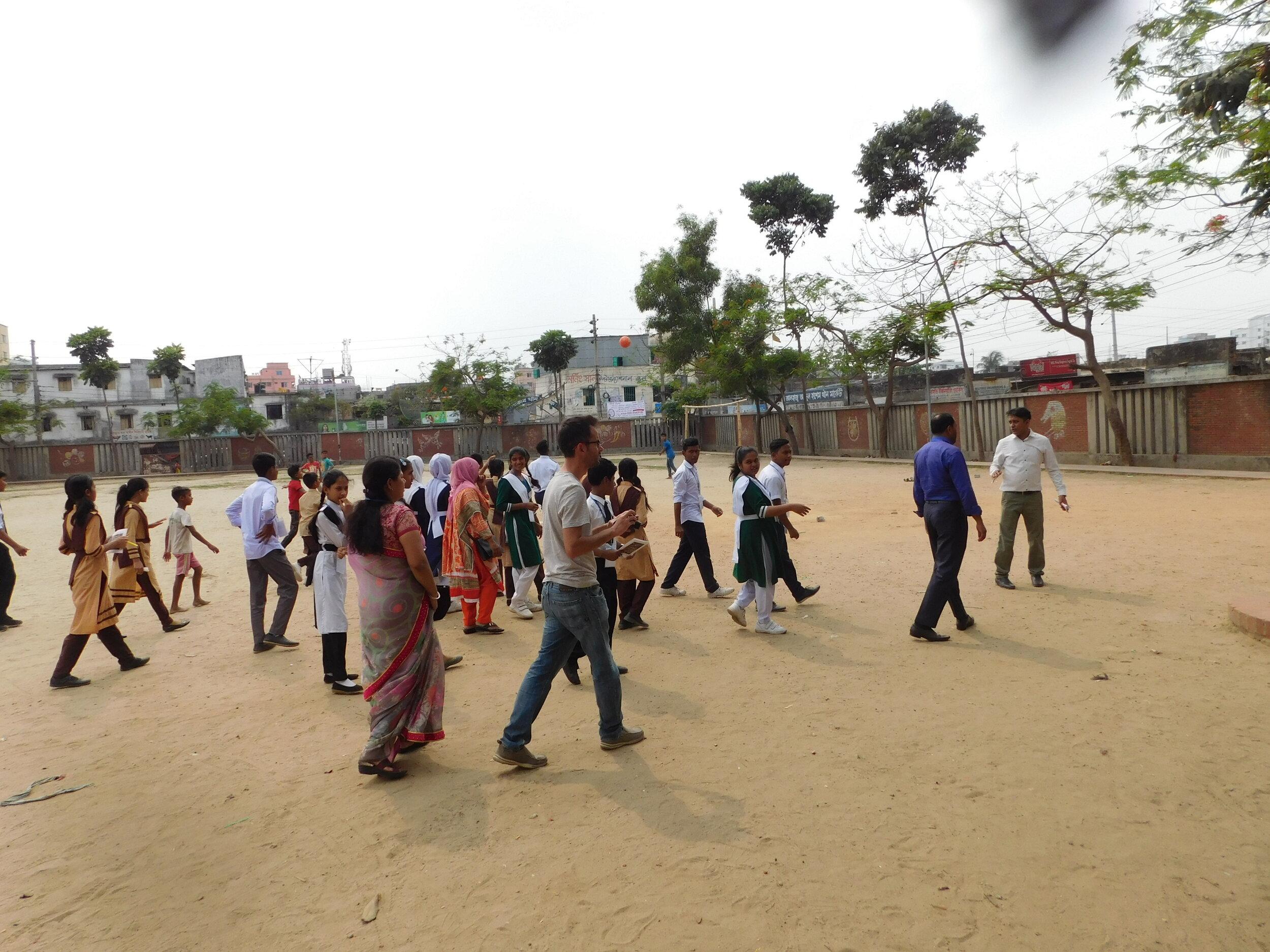 Local residents survey the open space during a site visit. Credit: UN-Habitat