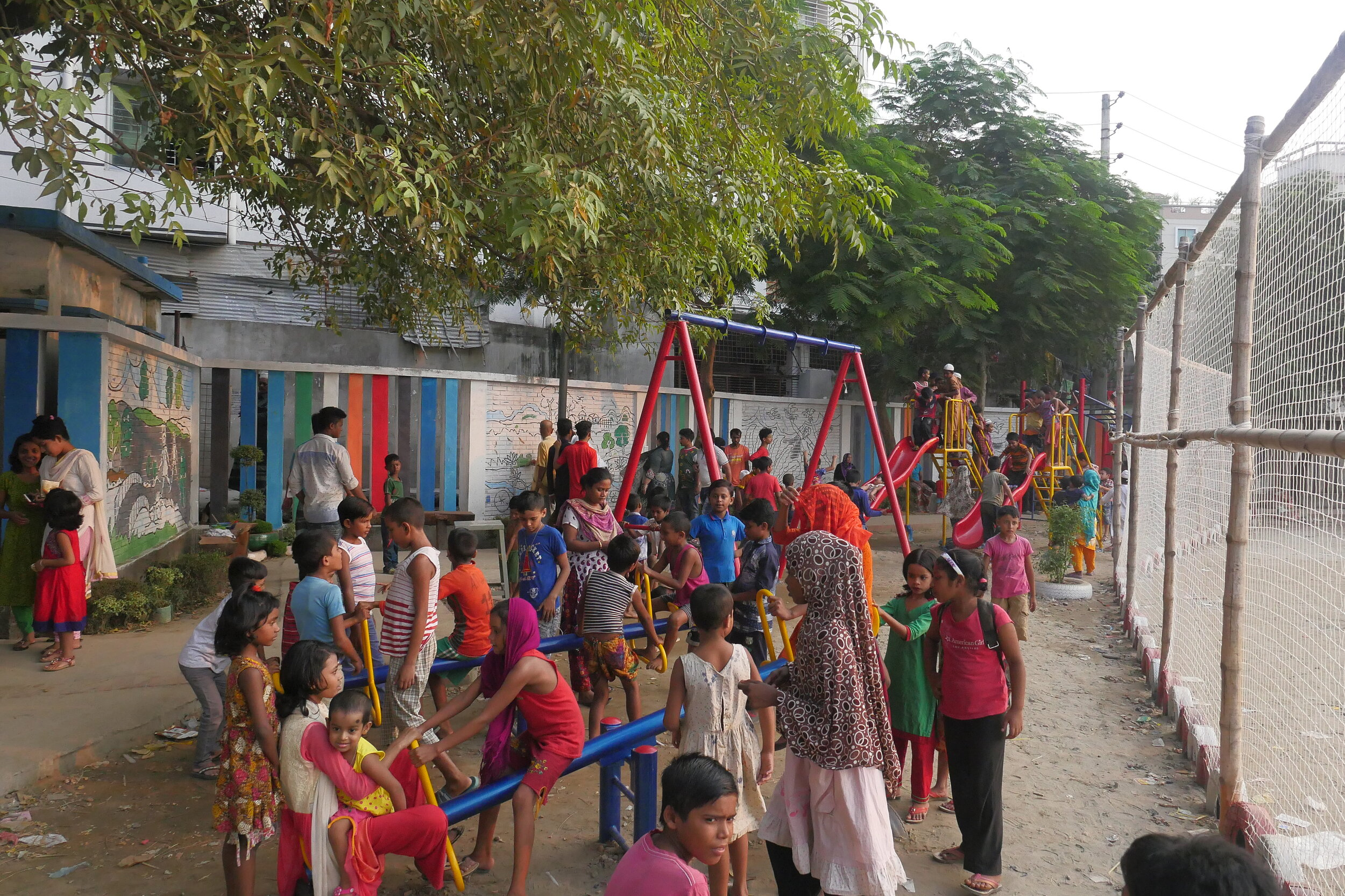 Dhaka residents gather at the renovated playground. Credit: UN-Habitat