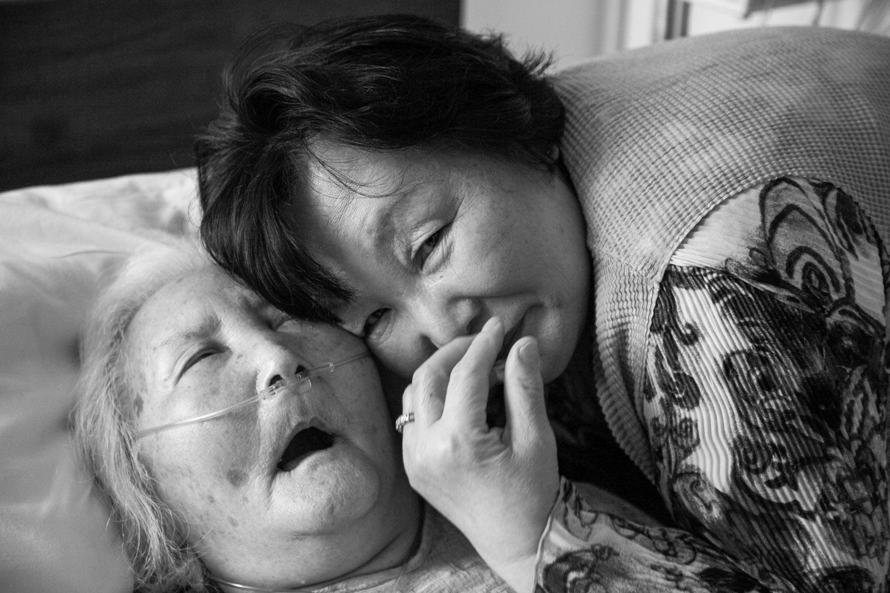 """A NEW CITIZEN""    A photo documentary that follows Hwayoung Shin, a recent immigrant from South Korea who came to the United States to care for her ailing mother who was stricken with Alzheimer's Disease. After her mother's passing, she makes the decision to stay in the U.S, as she attempts to learn American culture while maintaining her Korean heritage."