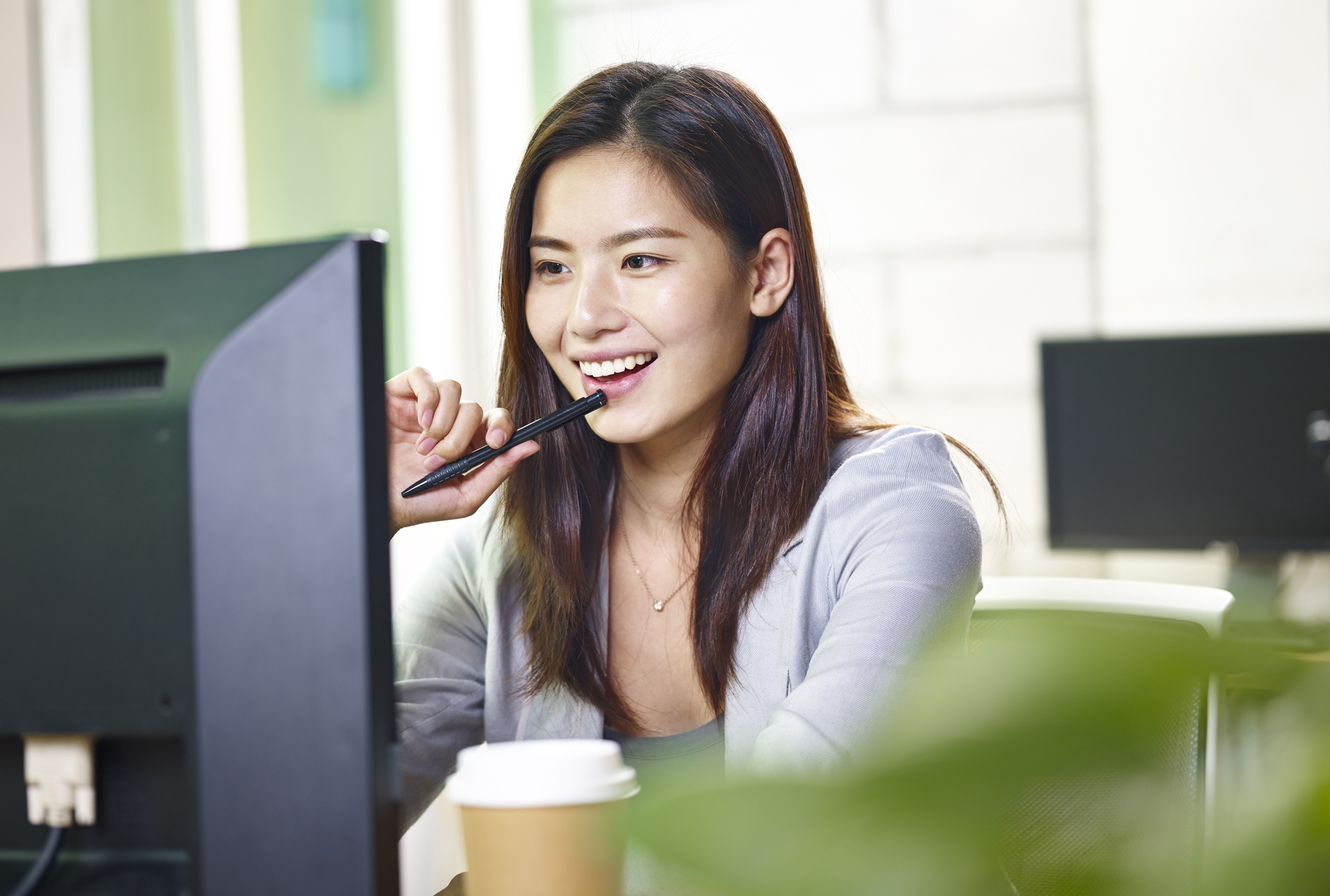 young-asian-business-woman-working-in-office-849386066_2003x1502.jpeg